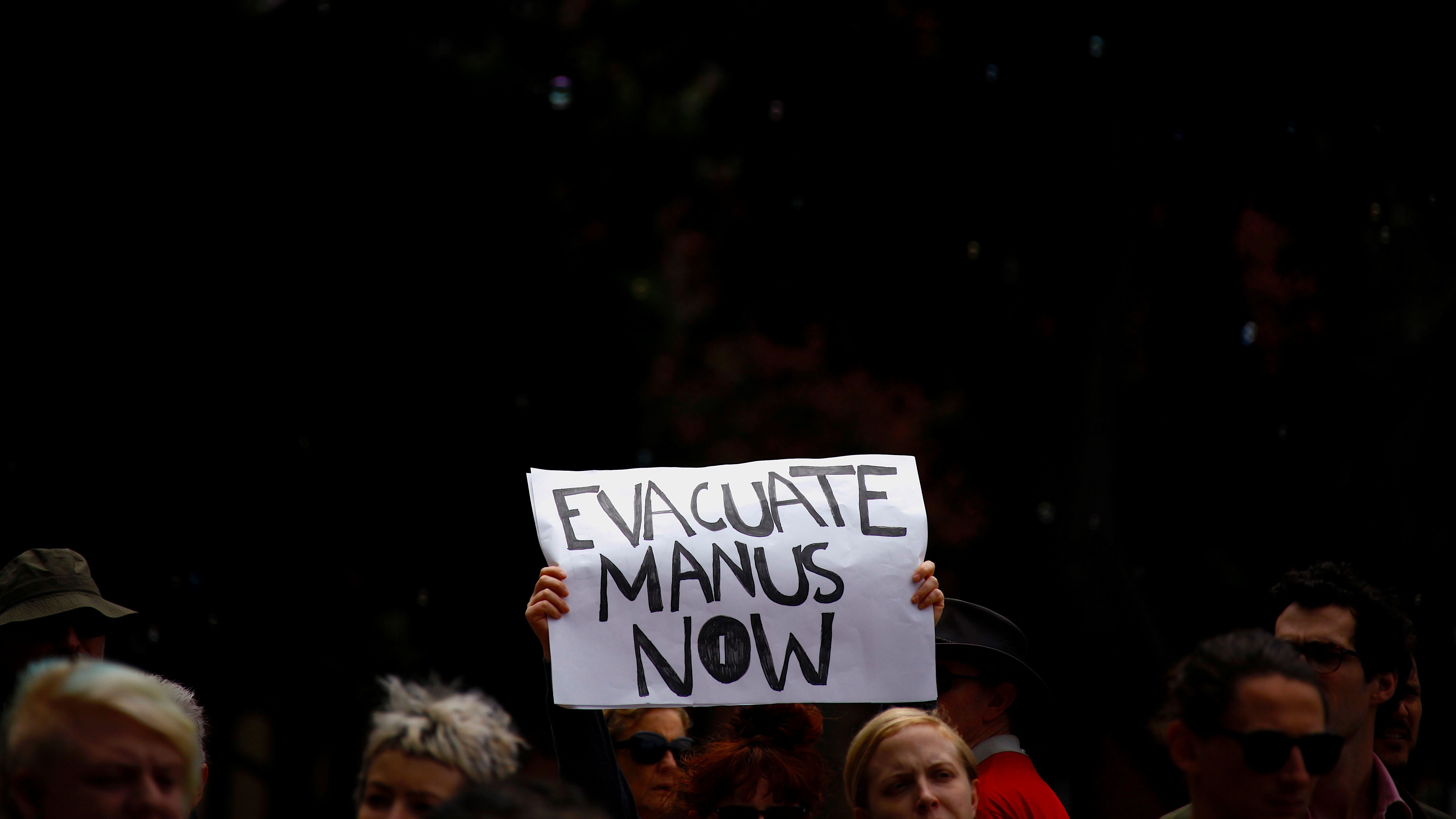 Refugee advocates hold placards as they participate in a protest in Sydney, Australia, against the treatment of asylum-seekers at Australia-run detention centres located at Nauru and Manus Island.