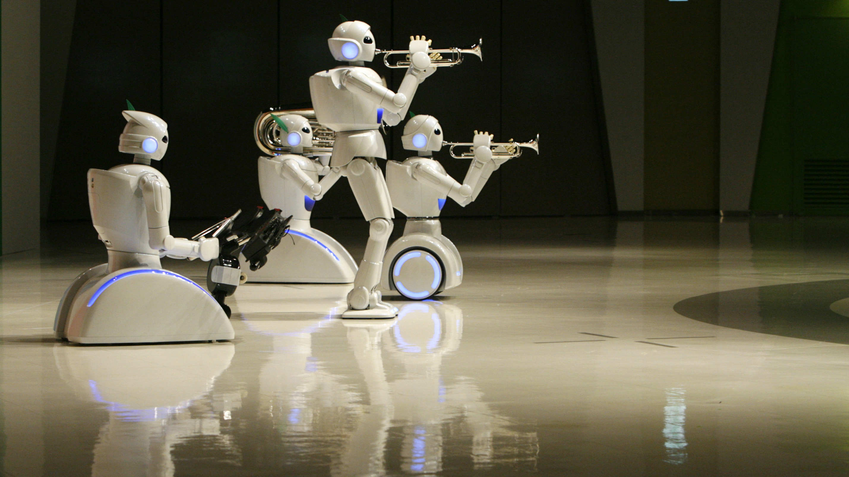Toyota Motor Corp's partner robots play instruments at the company's showroom in Tokyo