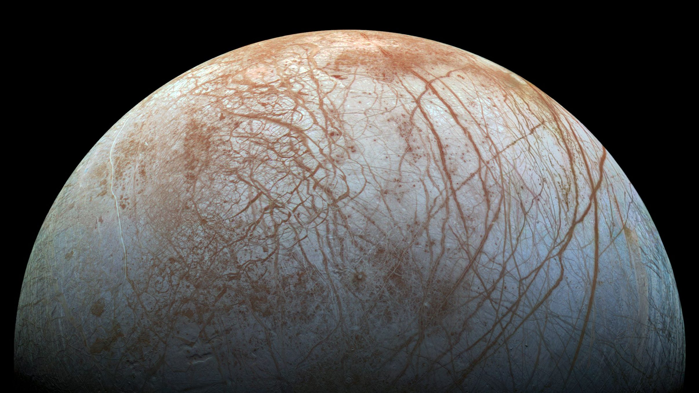 A new mosaic made from images taken by NASA's Galileo spacecraft in the late 1990's is shown of the surface of Jupiter's icy moon, Europa, as it looms large in this newly-reprocessed, higher resolution color view in this handout provided by NASA November 24, 2014. This newer version was created from images assembled into a realistic color view of the surface that approximates how Europa would appear to the human eye.