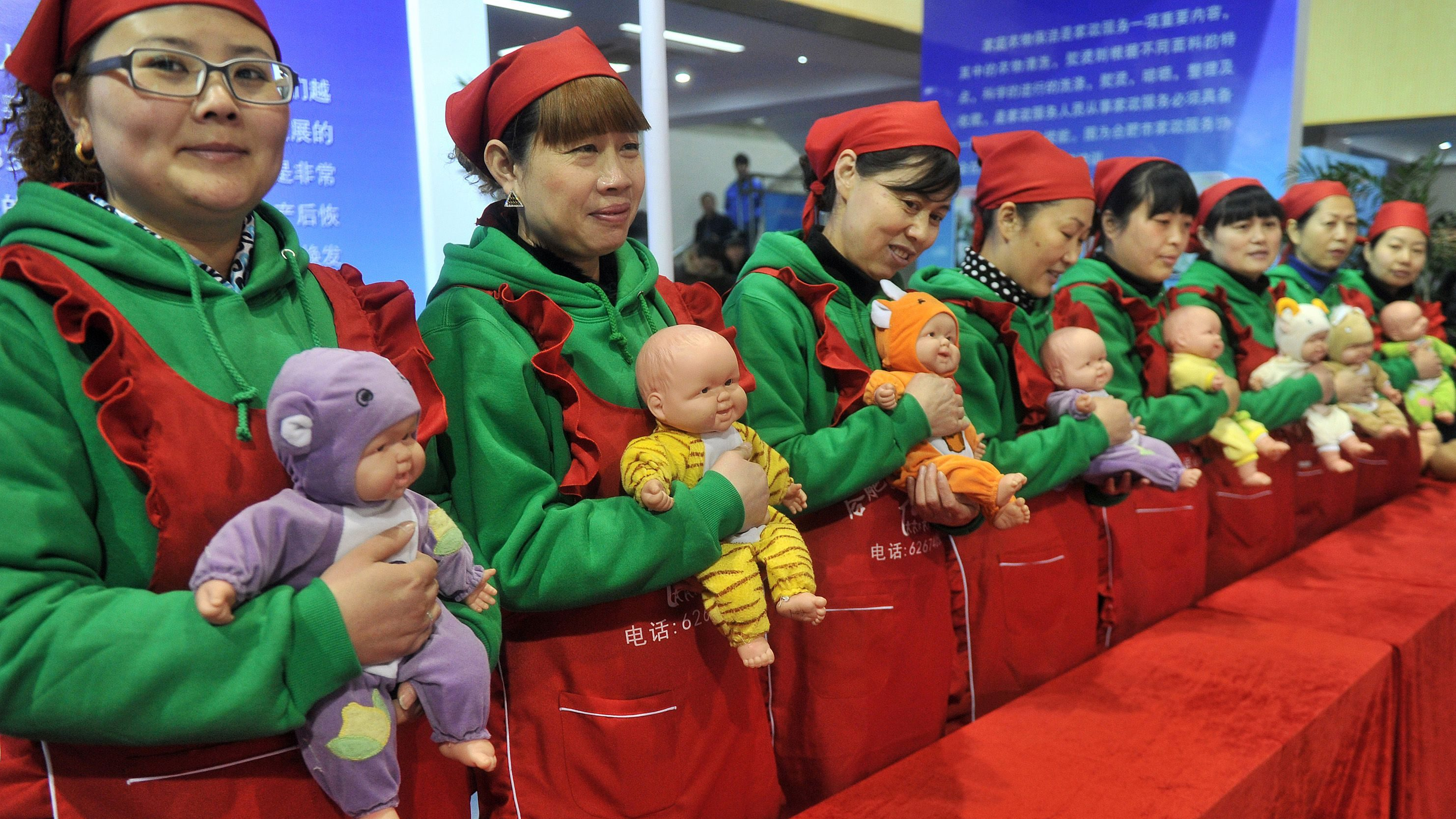 Maternity matrons demonstrate how to take care of babies during a skilled worker festival in Hefei, Anhui province, January 16, 2015. More than one hundred workers with various professions performed during the event, according to local media. REUTERS/Stringer (CHINA - Tags: SOCIETY) CHINA OUT. NO COMMERCIAL OR EDITORIAL SALES IN CHINA - GM1EB1G10LF01