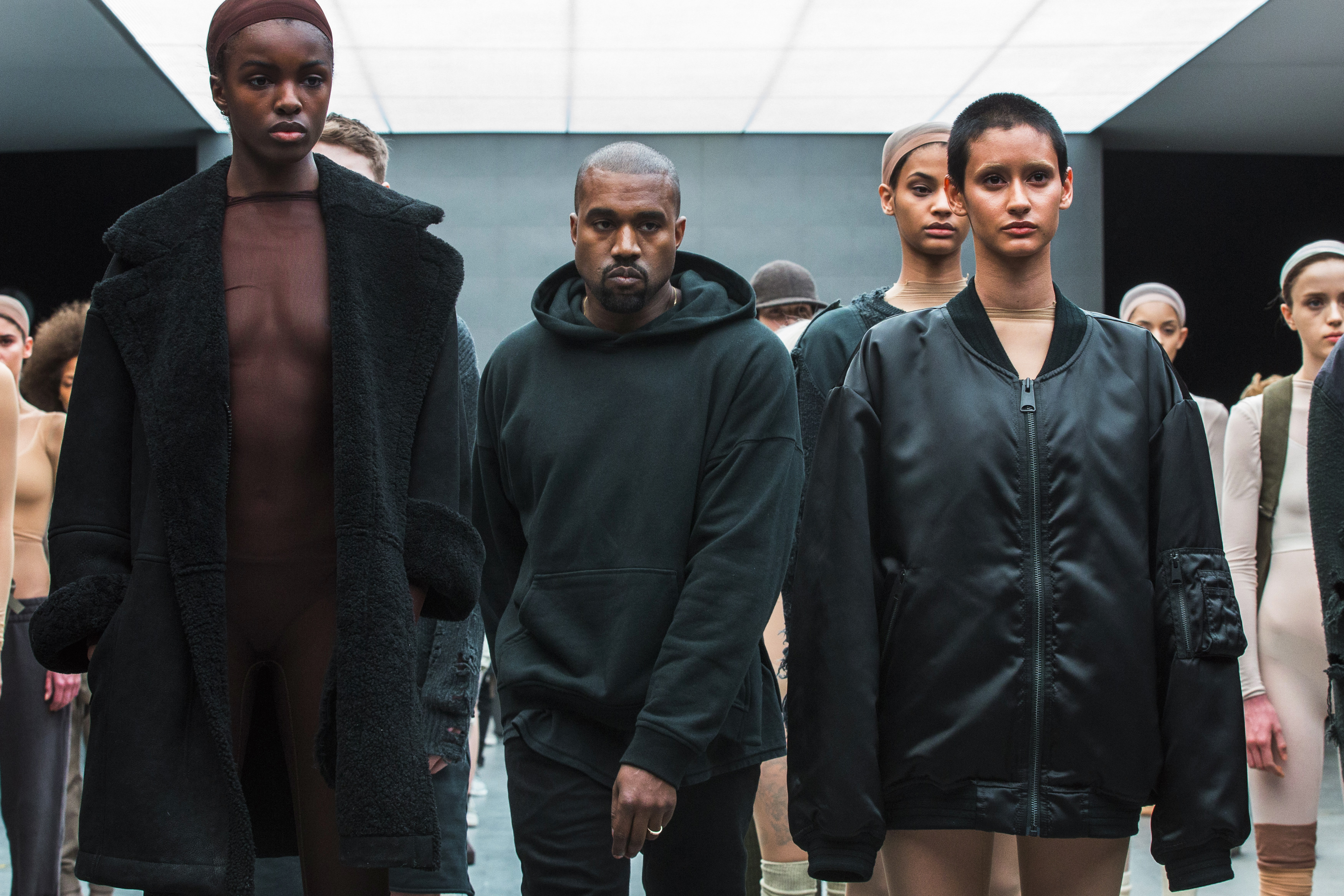 Singer Kanye West walks past models after presenting his Fall/Winter 2015 partnership line with Adidas at New York Fashion Week February 12, 2015. REUTERS/Lucas Jackson (UNITED STATES - Tags: FASHION SOCIETY ENTERTAINMENT) - GM1EB2D0NWX01