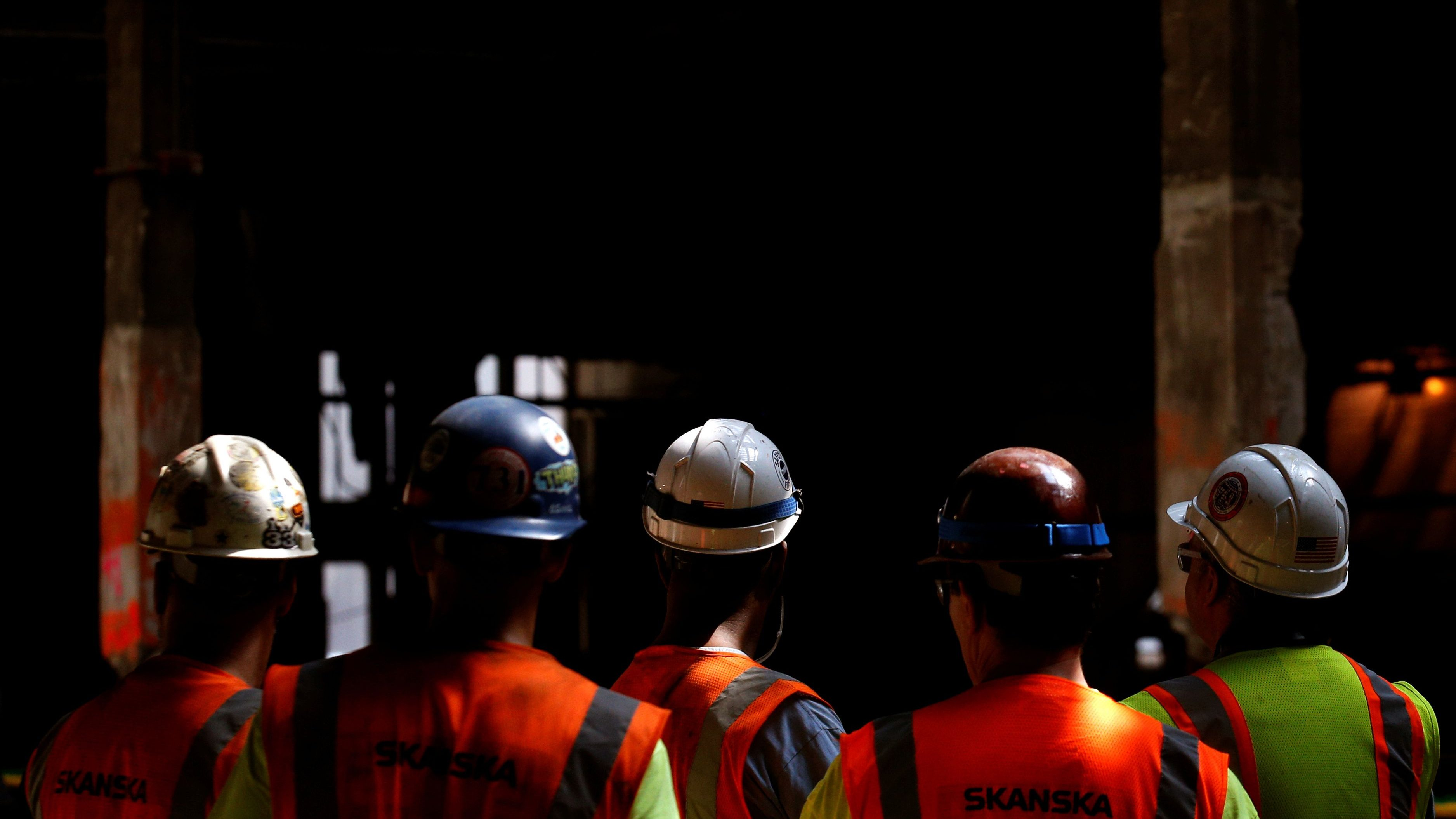 Workers in hard hats at a building site