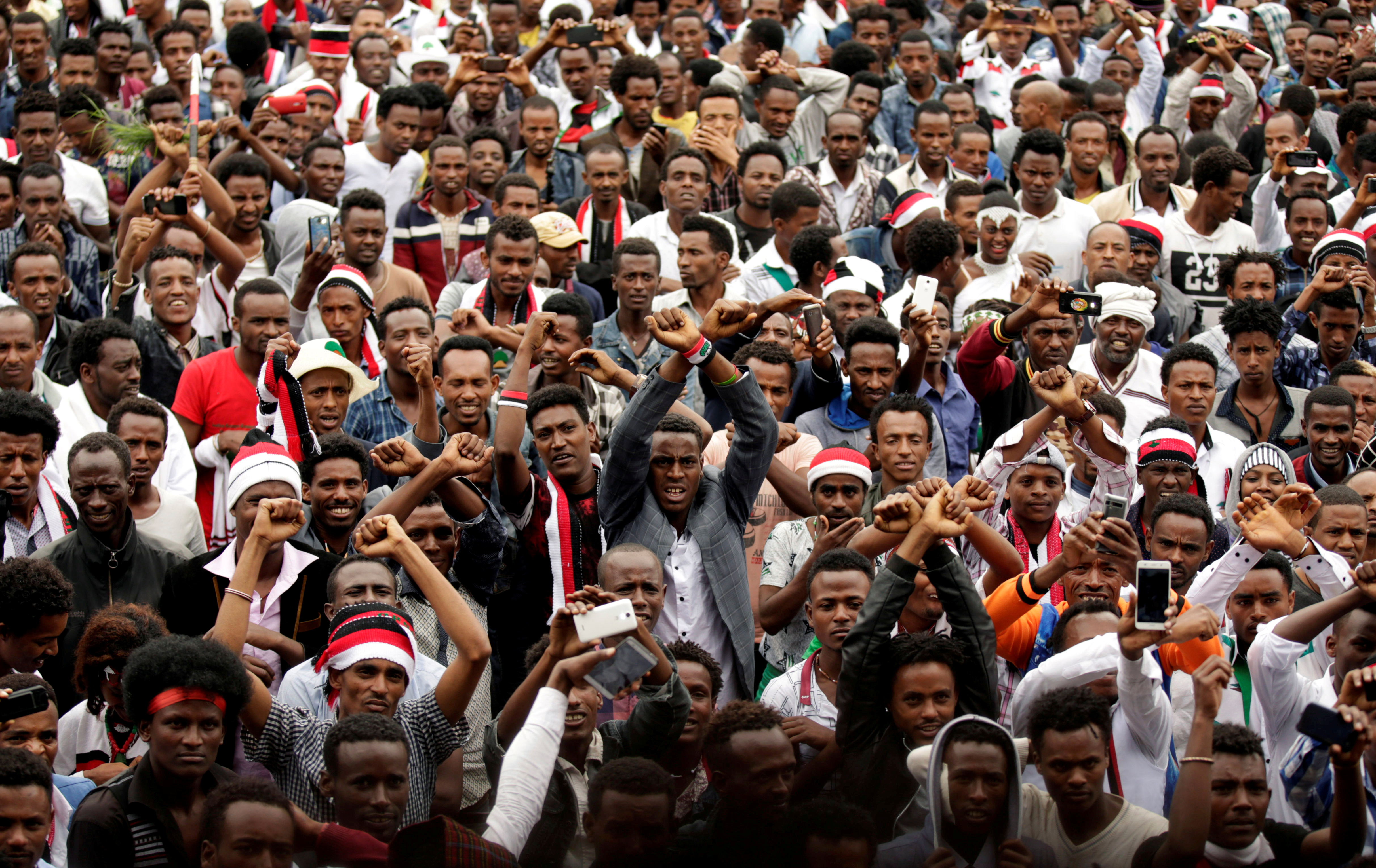 Demonstrators chant slogans while flashing the Oromo protest gesture during celebrations for Irreecha, the thanksgiving festival of the Oromo people, in Bishoftu town, Oromia region, Ethiopia, October 1, 2017.