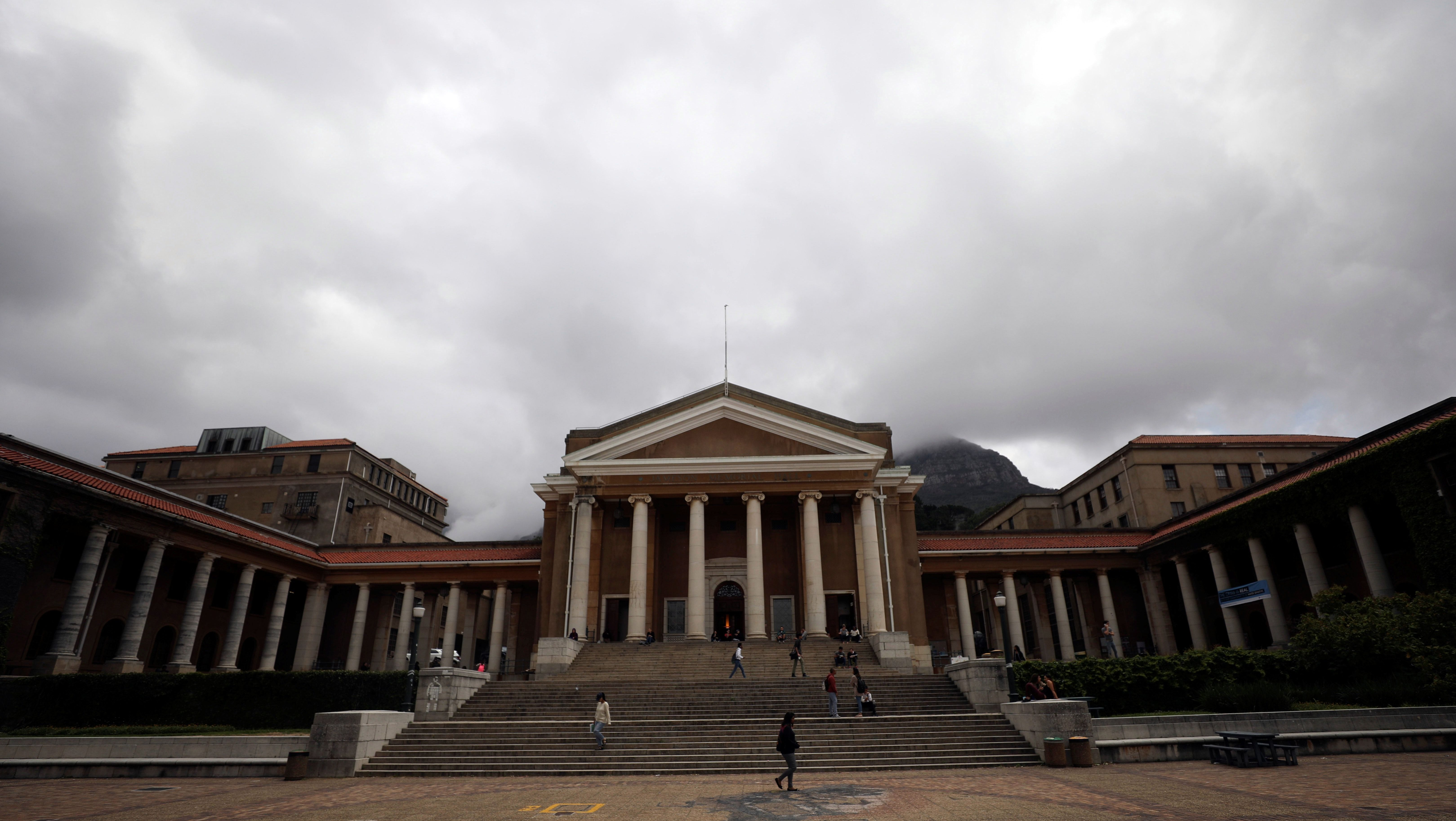 Students walk accross a plaza in front of the University of Cape Town in Cape Town