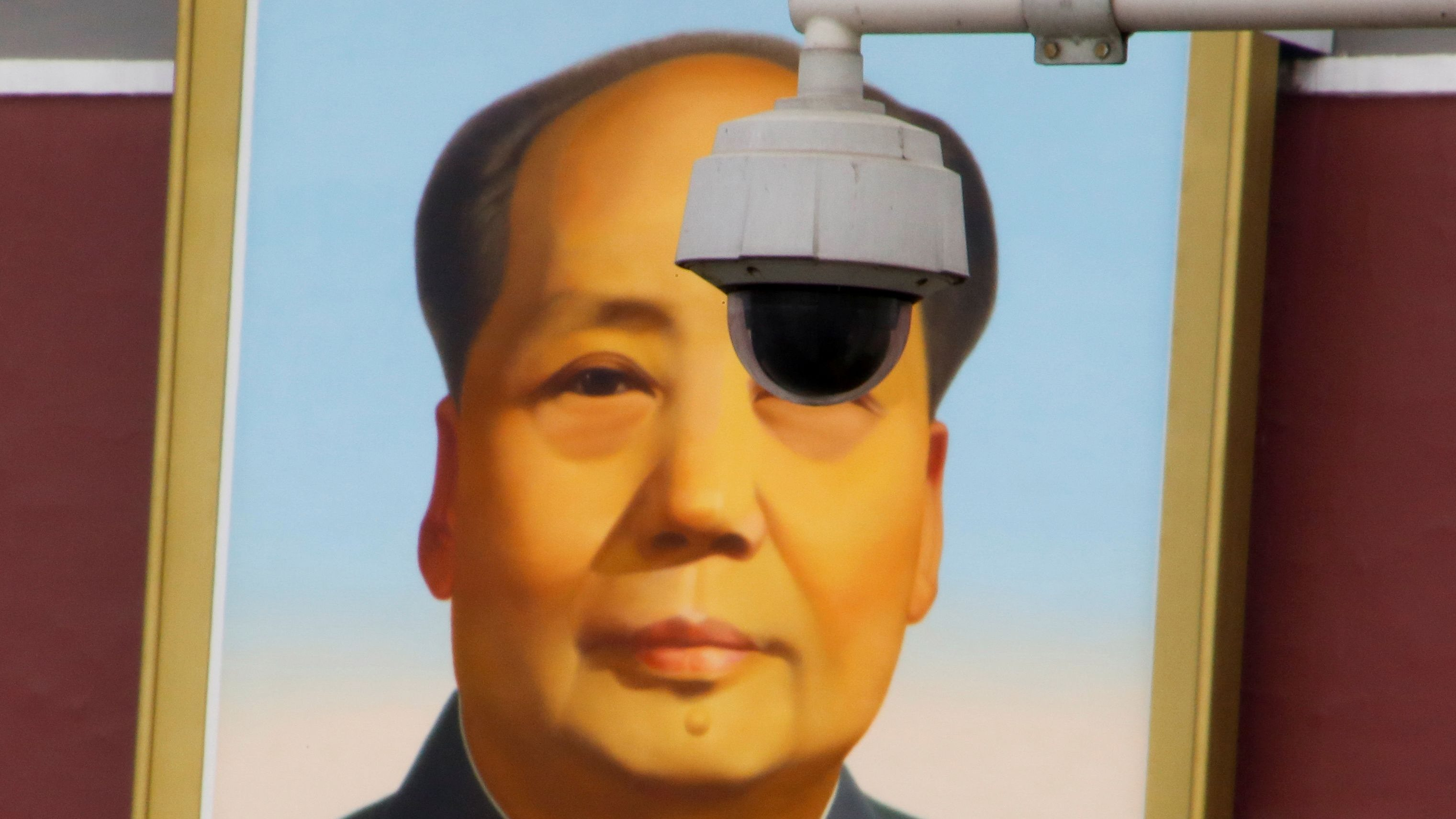 A security camera overlooks Tiananmen Square in front of a portrait of the late Chinese Chairman Mao Zedong in Beijing, China March 6, 2018.