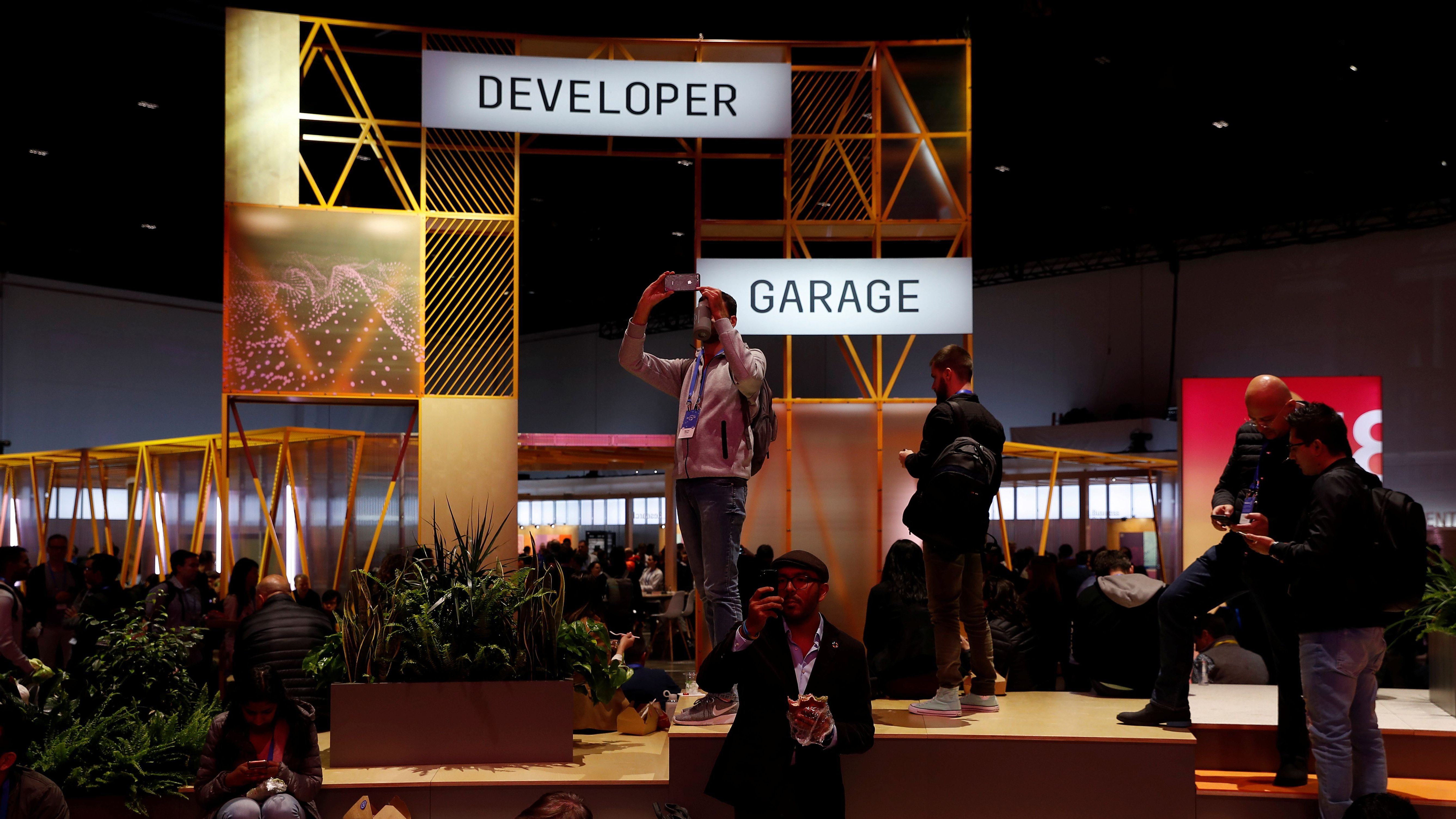 Attendees are seen in the festival hall during Facebook Inc's annual F8 developers conference in San Jose, California, U.S. May 1, 2018. REUTERS/Stephen Lam
