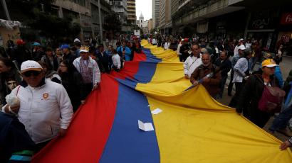 Demonstrators hold a flag during a rally commemorating May Day in Bogota, Colombia May 1, 2018.