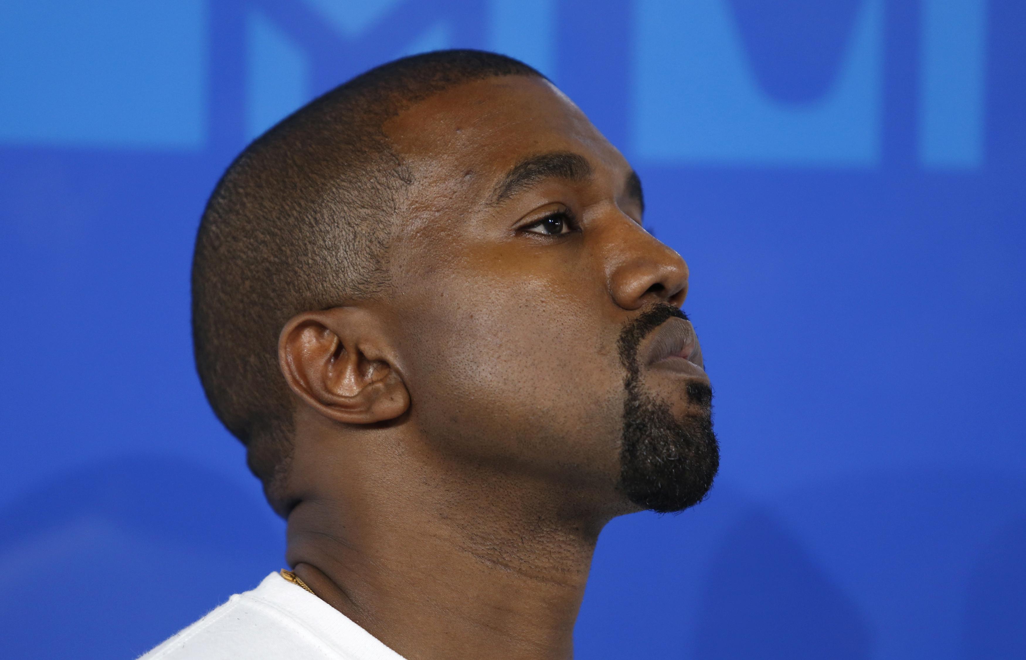 Rapper Kanye West arrives at the 2016 MTV Video Music Awards.