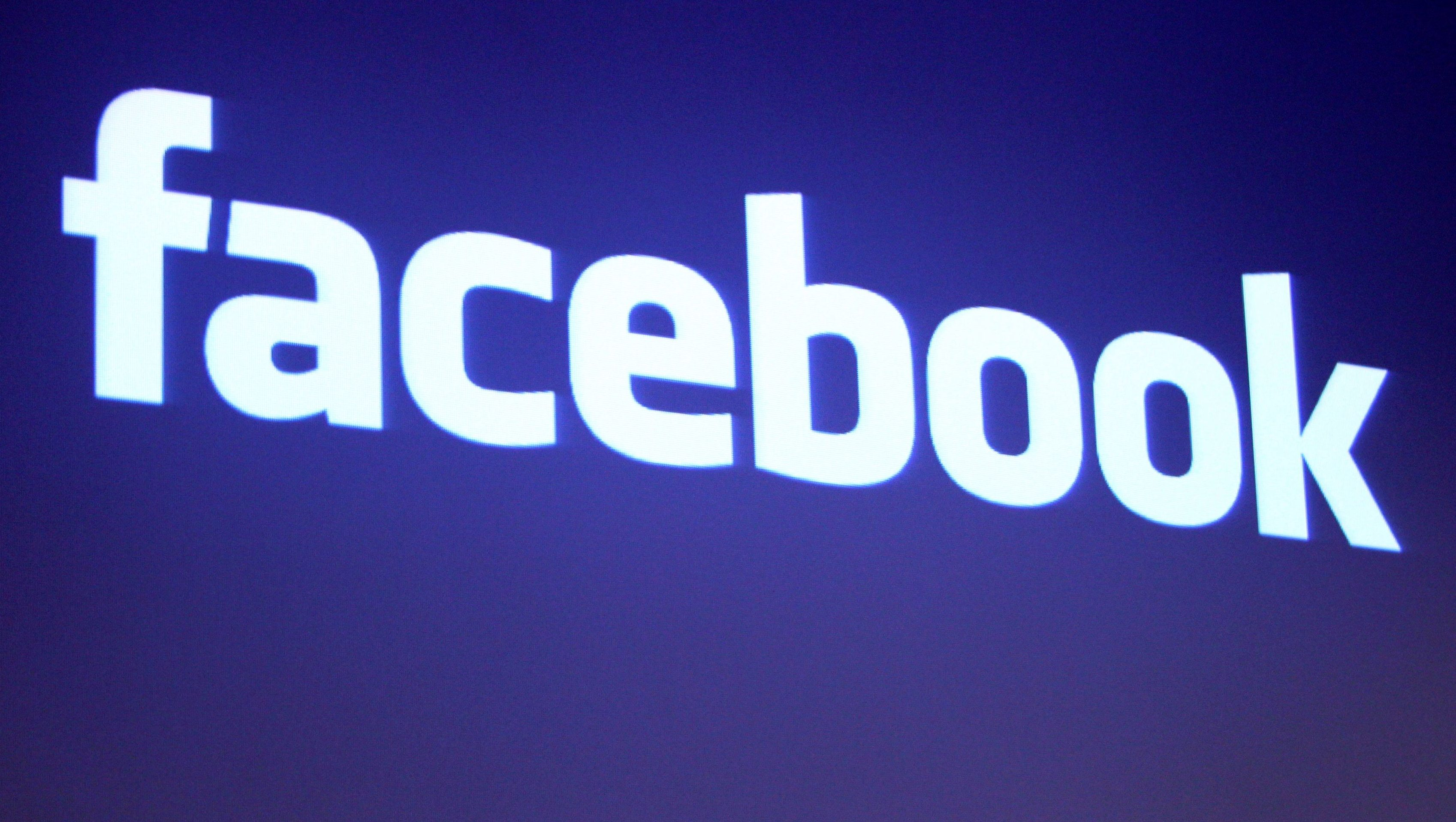 FILE PHOTO - The Facebook logo is shown at Facebook headquarters in Palo Alto, California, U.S. May 26, 2010. REUTERS/Robert Galbraith/File Photo - RC1AE080F140