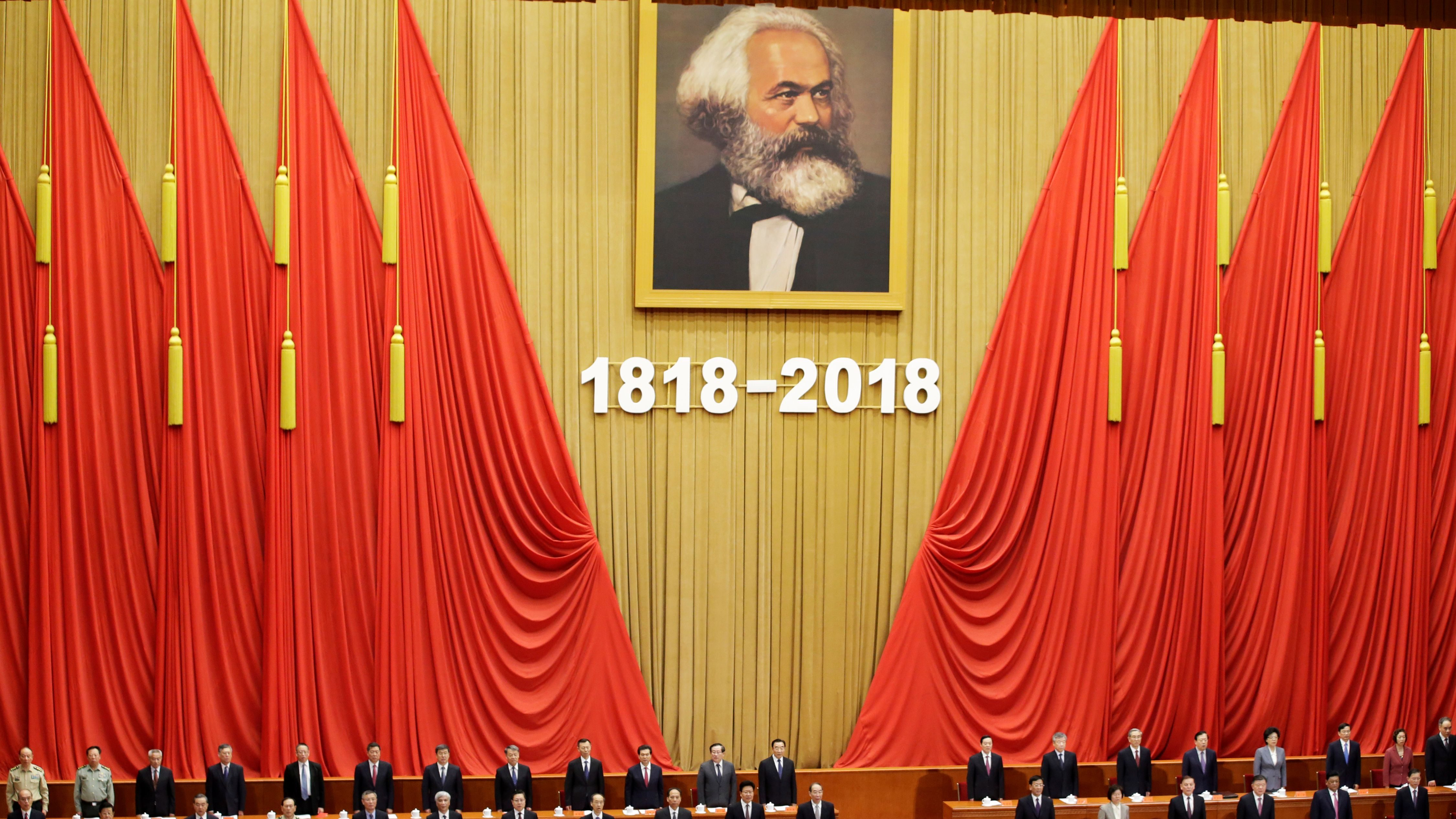 Chinese President Xi Jinping and other officials sing the national anthem at an event commemorating the 200th birth anniversary of Karl Marx, in Beijing, China May 4, 2018.