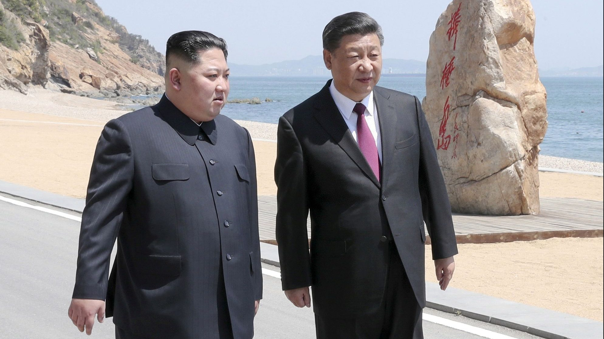 Chinese President Xi Jinping and North Korean leader Kim Jong Un meet in Dalian, Liaoning province, China in this picture released by Xinhua on May 8, 2018.