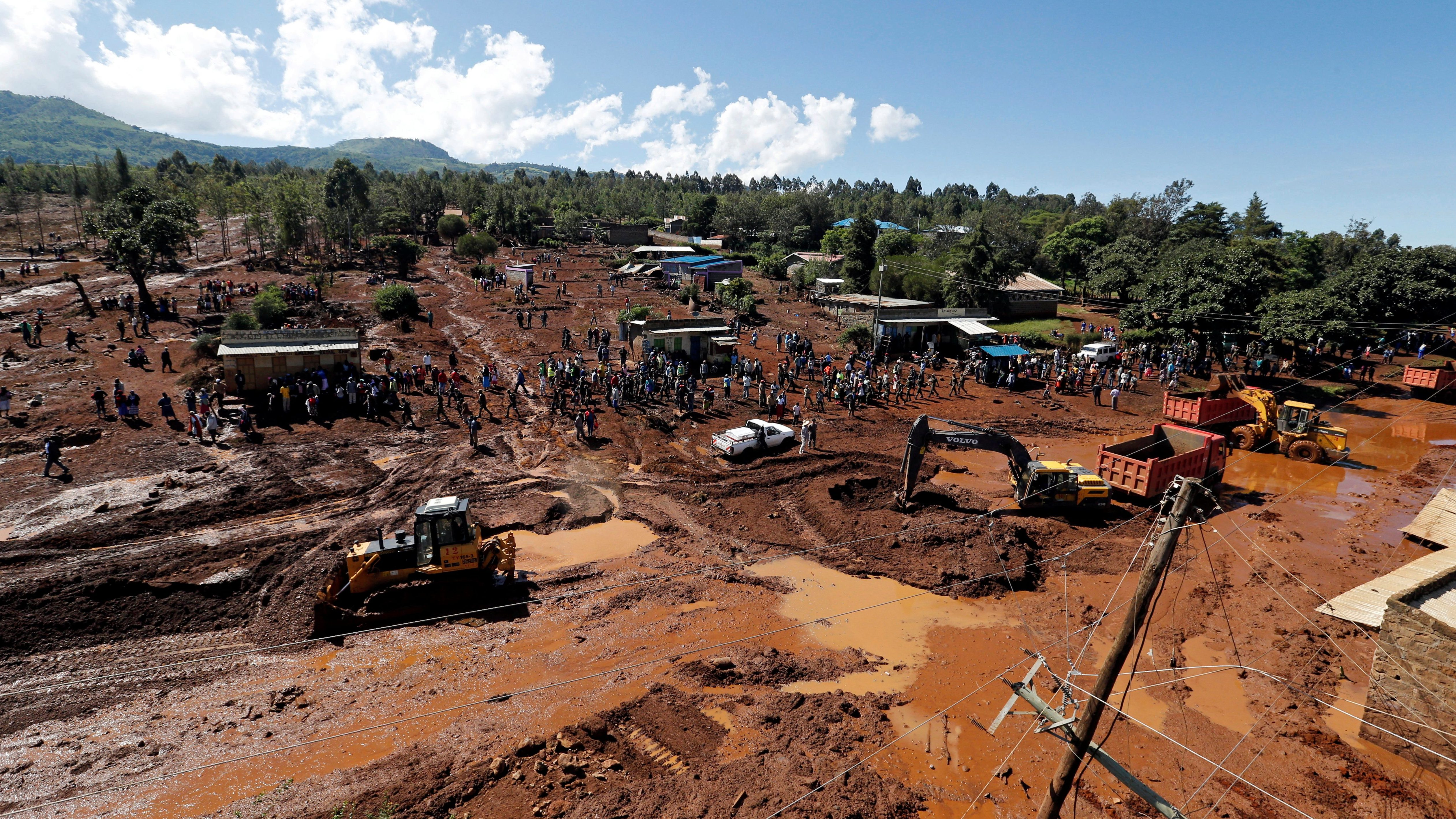 An aerial view of rescue efforts near destroyed houses by flooding water after a dam burst, in Solio town near Nakuru, Kenya May 10, 2018.