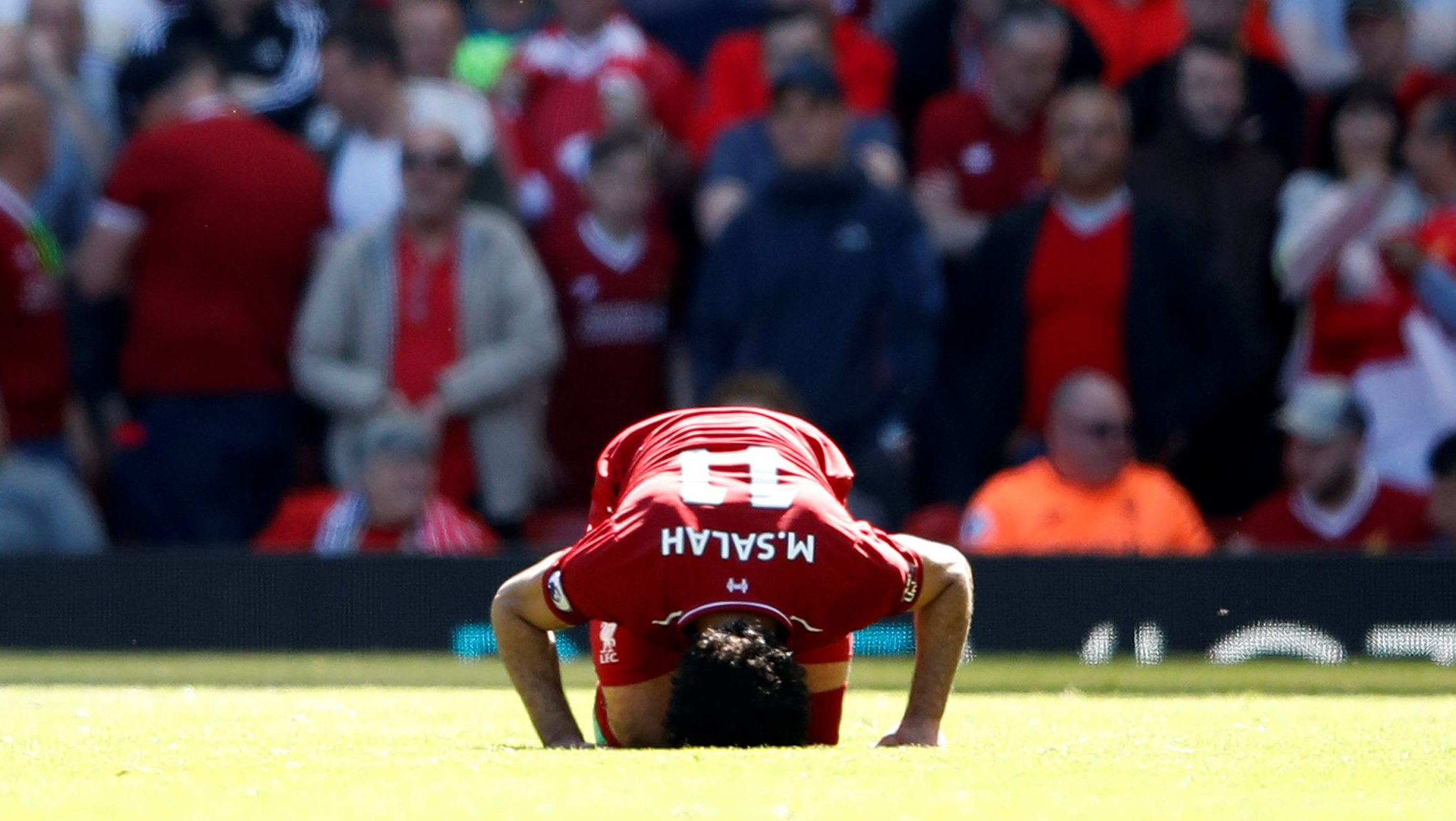 Soccer Football - Premier League - Liverpool vs Brighton & Hove Albion - Anfield, Liverpool, Britain - May 13, 2018   Liverpool's Mohamed Salah celebrates scoring their first goal.