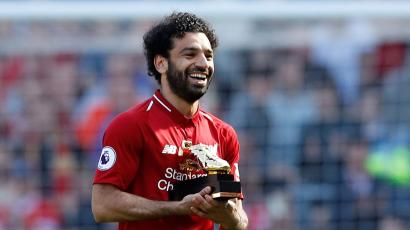 "Soccer Football - Premier League - Liverpool vs Brighton & Hove Albion - Anfield, Liverpool, Britain - May 13, 2018 Liverpool's Mohamed Salah celebrates with the Golden Boot after the match Action Images via Reuters/Carl Recine EDITORIAL USE ONLY. No use with unauthorized audio, video, data, fixture lists, club/league logos or ""live"" services. Online in-match use limited to 75 images, no video emulation. No use in betting, games or single club/league/player publications. Please contact your account representative for further details. - RC1848F56C90"