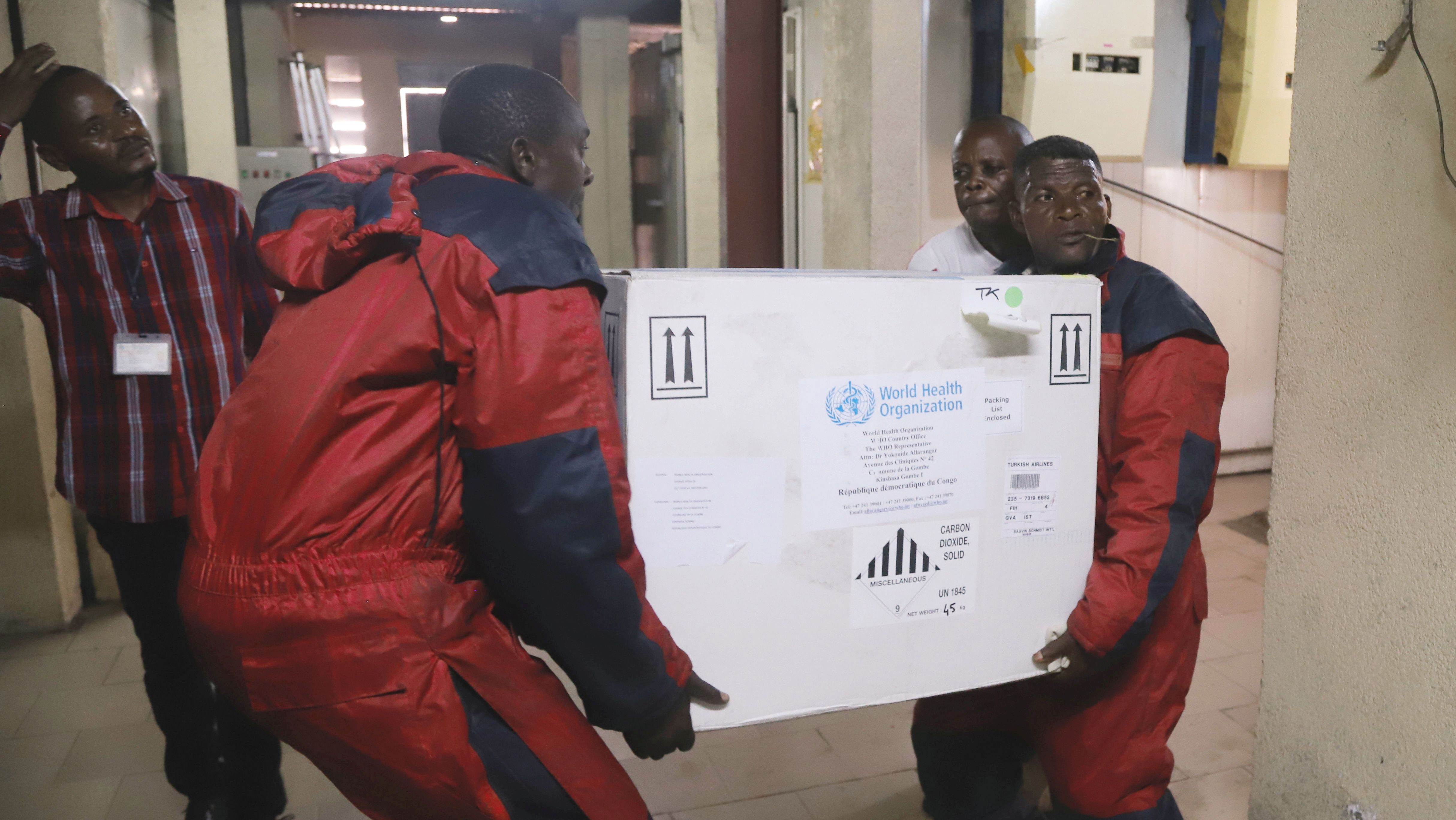 Congolese Health Ministry officials carry the first batch of experimental Ebola vaccines in Kinshasa, Democratic Republic of Congo May 16, 2018.