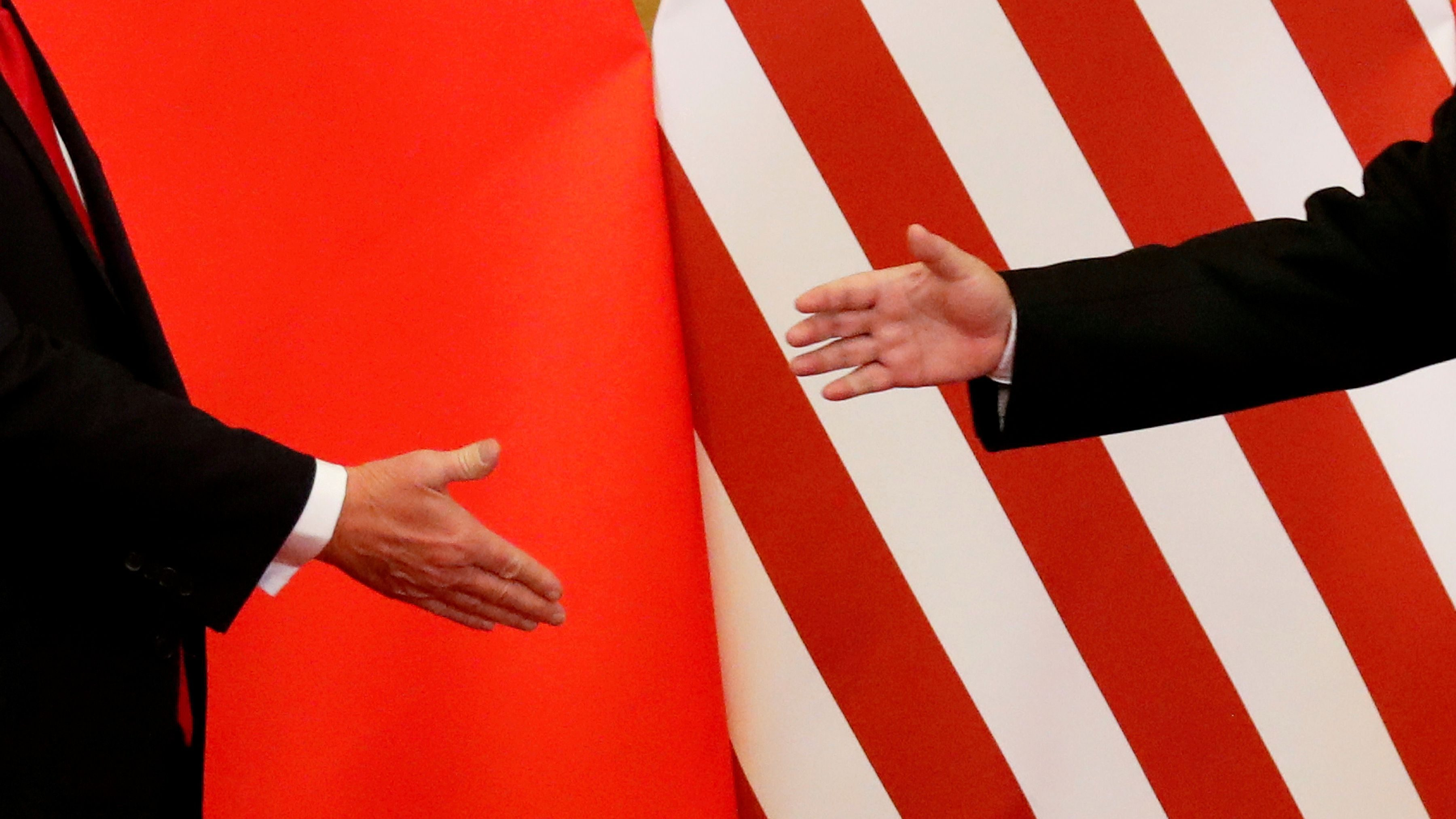 U.S. President Donald Trump and China's President Xi Jinping shake hands after making joint statements at the Great Hall of the People in Beijing, China, November 9, 2017.