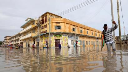 A man wades through a flooded street in Hamerweyne district of Mogadishu, Somalia May 20, 2018.