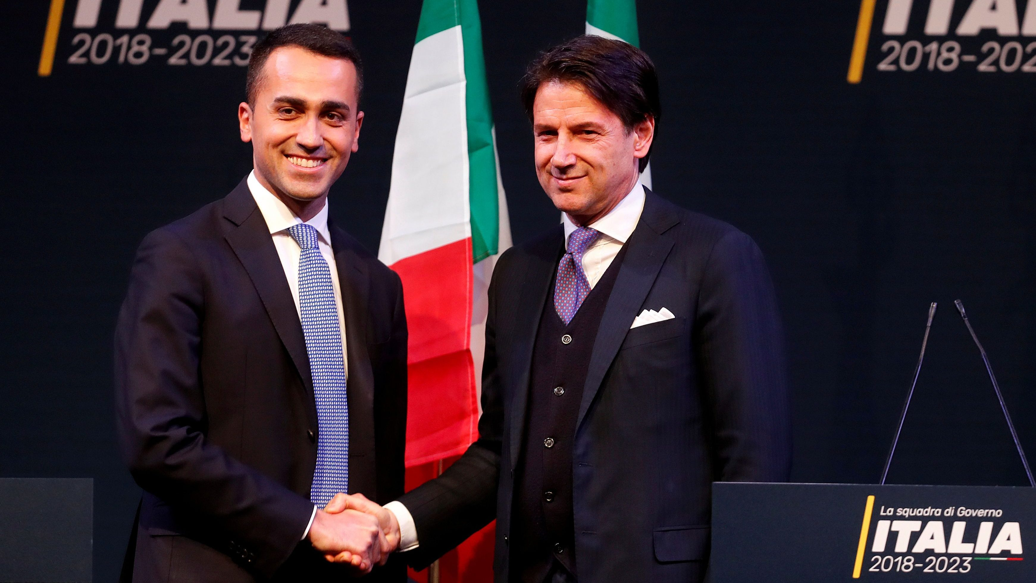 FILE PHOTO: 5-Star Movement leader Di Maio shakes hands with Giuseppe Conte in Rome ahead of Italy's election, March 1, 2018. REUTERS/Remo Casilli/File Photo - RC14483CEBC0