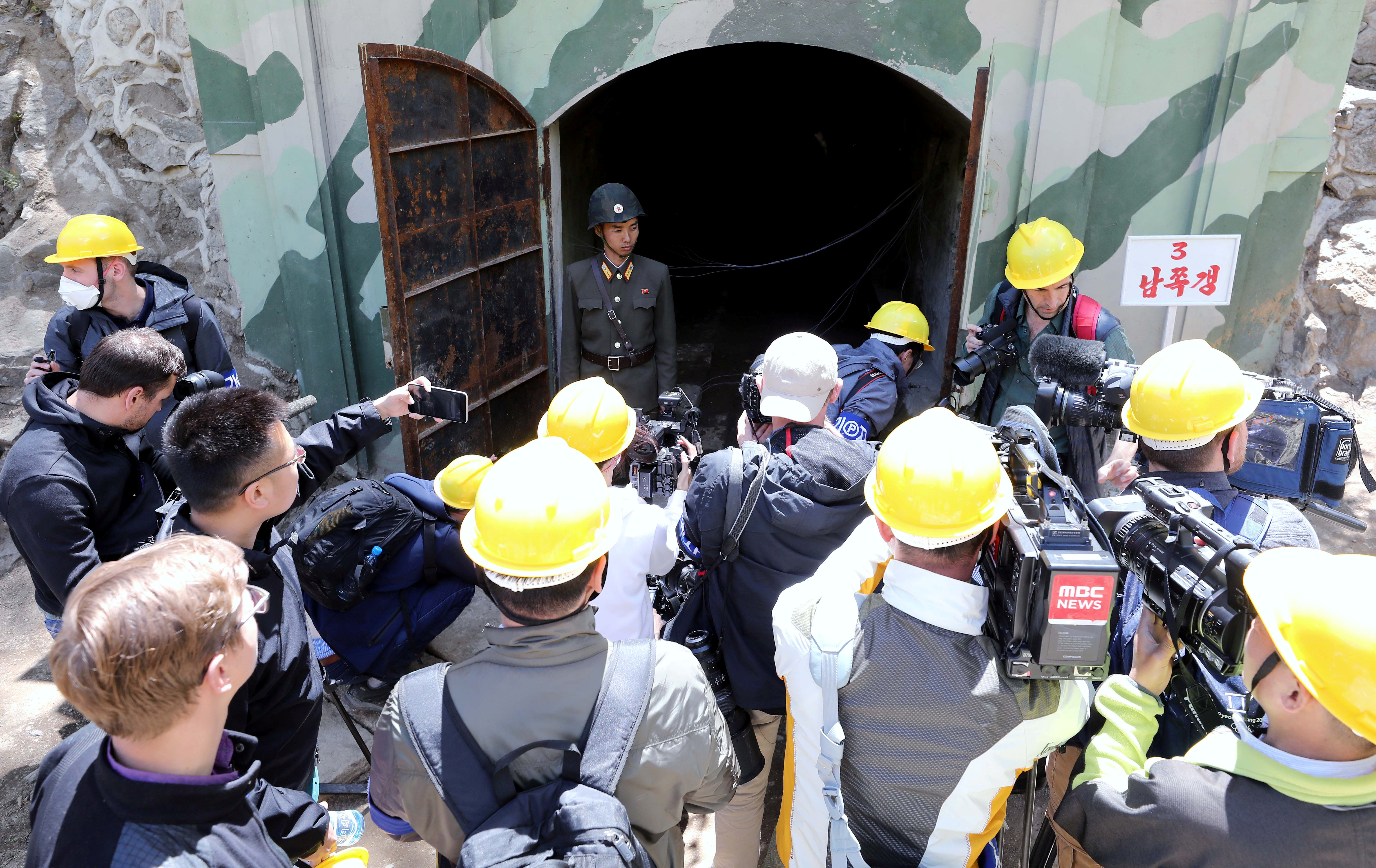 Journalists look around the 3rd tunnel of Punggye-ri nuclear test ground before it is blown up during the dismantlement process in Punggye-ri, North Hamgyong Province, North Korea May 24, 2018.