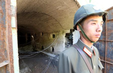 A North Korean soldier stands guard in front of the third tunnel of Punggye-ri nuclear test ground before it is blown up during the dismantlement process in Punggye-ri, North Hamgyong Province, North Korea May 24, 2018. Picture taken May 24, 2018