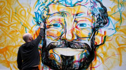 Guy McKinley paints mural of Liverpool's start striker Mo Salah from Egypt on hoarding in Liverpool's city centre ahead of his team's Champions League final in Kiev against Real Madrid tomorrow, in Liverpool