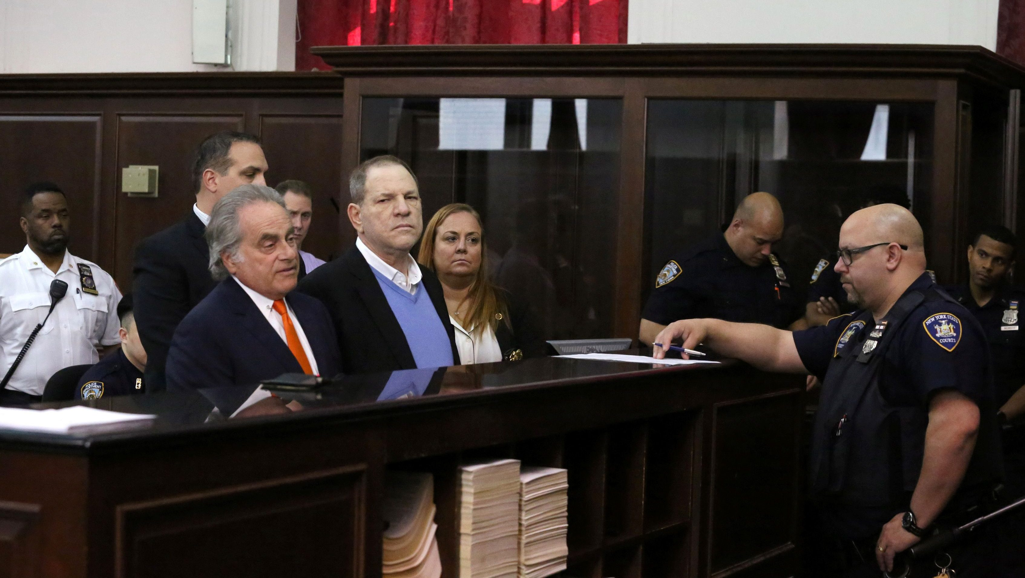 Film producer Harvey Weinstein stands with his lawyer Benjamin Brafman inside Manhattan Criminal Court during his arraignment in Manhattan in New York, U.S., May 25, 2018. Jefferson Siegel /Pool via REUTERS - RC16841D0670
