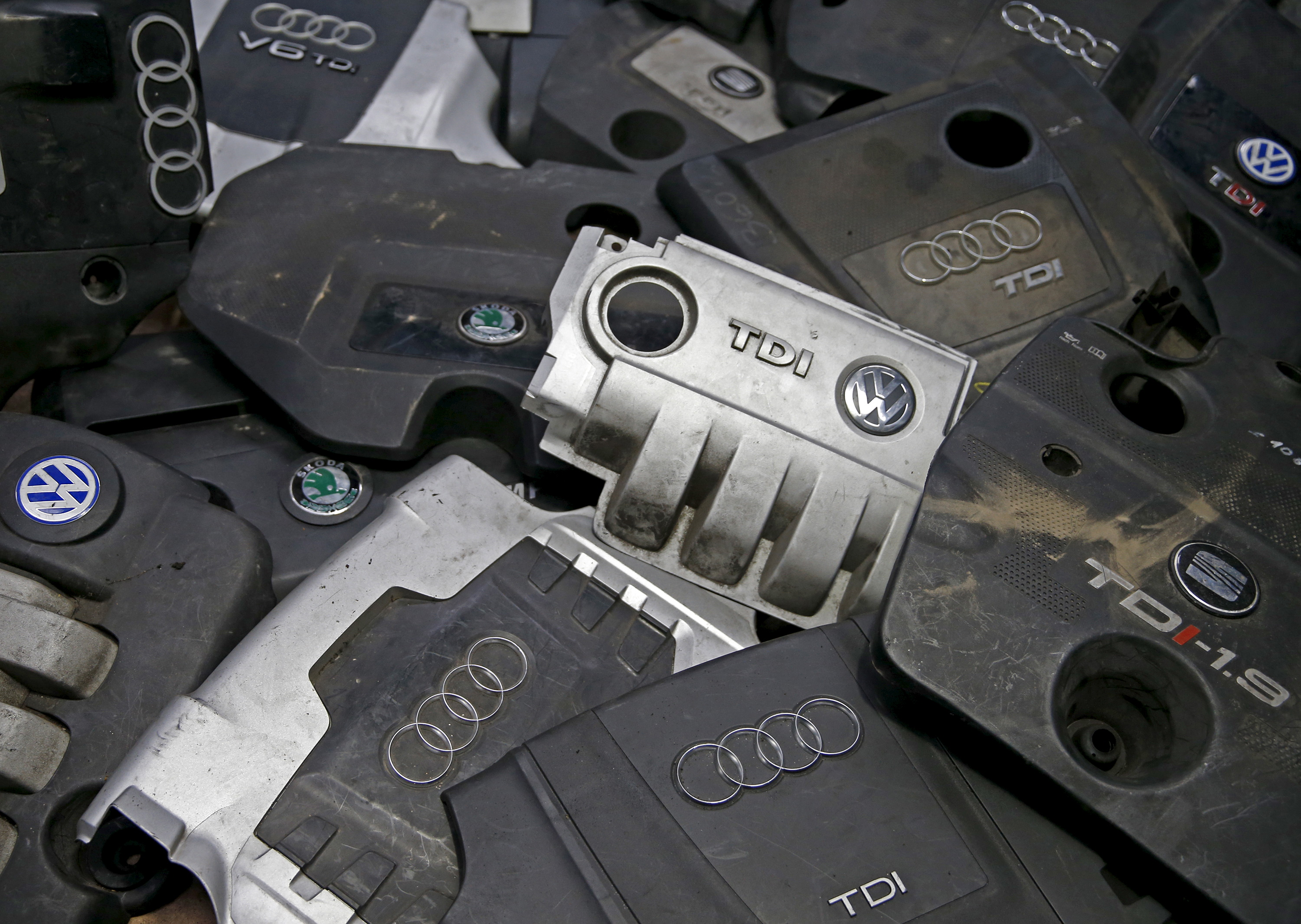 Covers for TDI diesel Volkswagen, Audi, SEAT and Skoda engines are seen in Jelah, Bosnia and Herzegovina, in this September 29, 2015 picture illustration. Volkswagen said on Tuesday it will repair up to 11 million vehicles and overhaul its namesake brand following the scandal over its rigging of emissions tests. The German carmaker said previously about 11 million vehicles were fitted with software capable of cheating emissions tests, including 5 million at its VW brand, 2.1 million at luxury brand Audi, 1.2 million at Skoda and 1.8 million light commercial vehicles. About 700,000 of the 11 million diesel engines involved in scandal were manufactured by the company's brand Seat, a spokesman for the Spanish unit said on Tuesday. Refitting 11 million cars would be among the biggest recalls in history by a single automaker. REUTERS/Dado Ruvic - GF10000226855