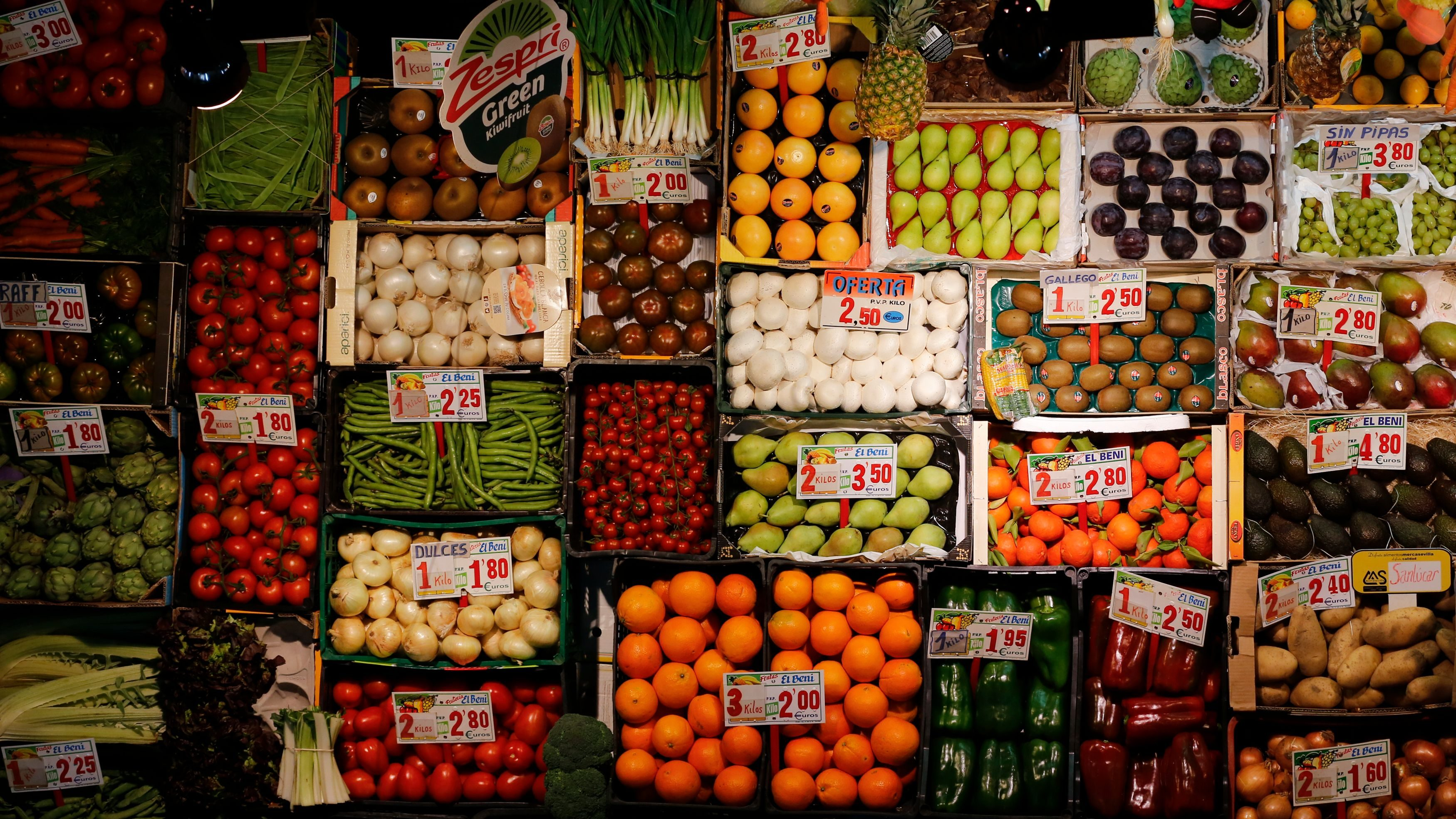 Fruits and vegetables are displayed to be sell at a shop of a food market in the Andalusian capital of Seville, southern Spain March 7, 2016.