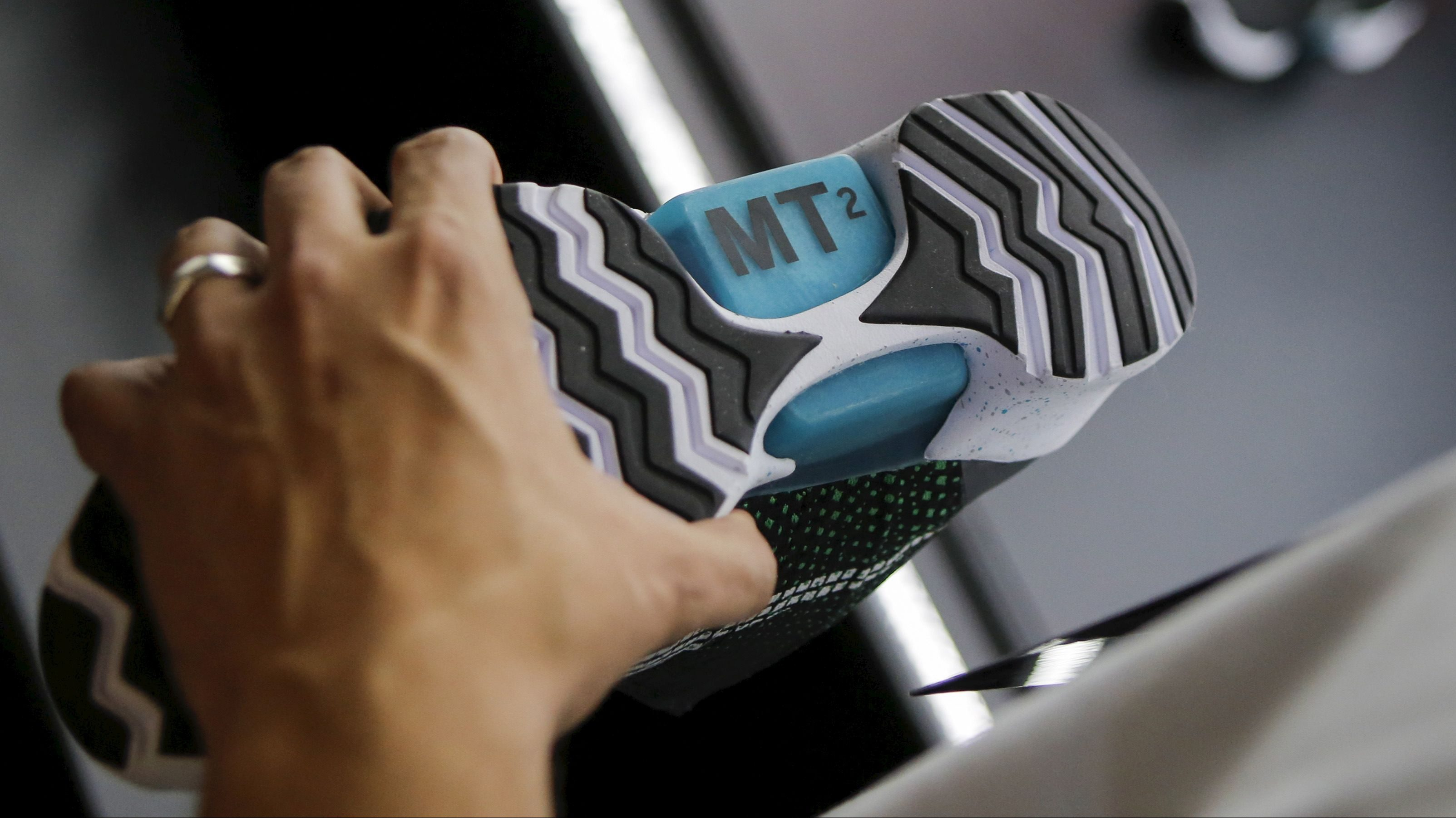 A man takes a look at the new Nike HyperAdapt sneakers with self-lacing technology during an unveiling event in New York, March 17, 2016. REUTERS/Eduardo Munoz - GF10000349629