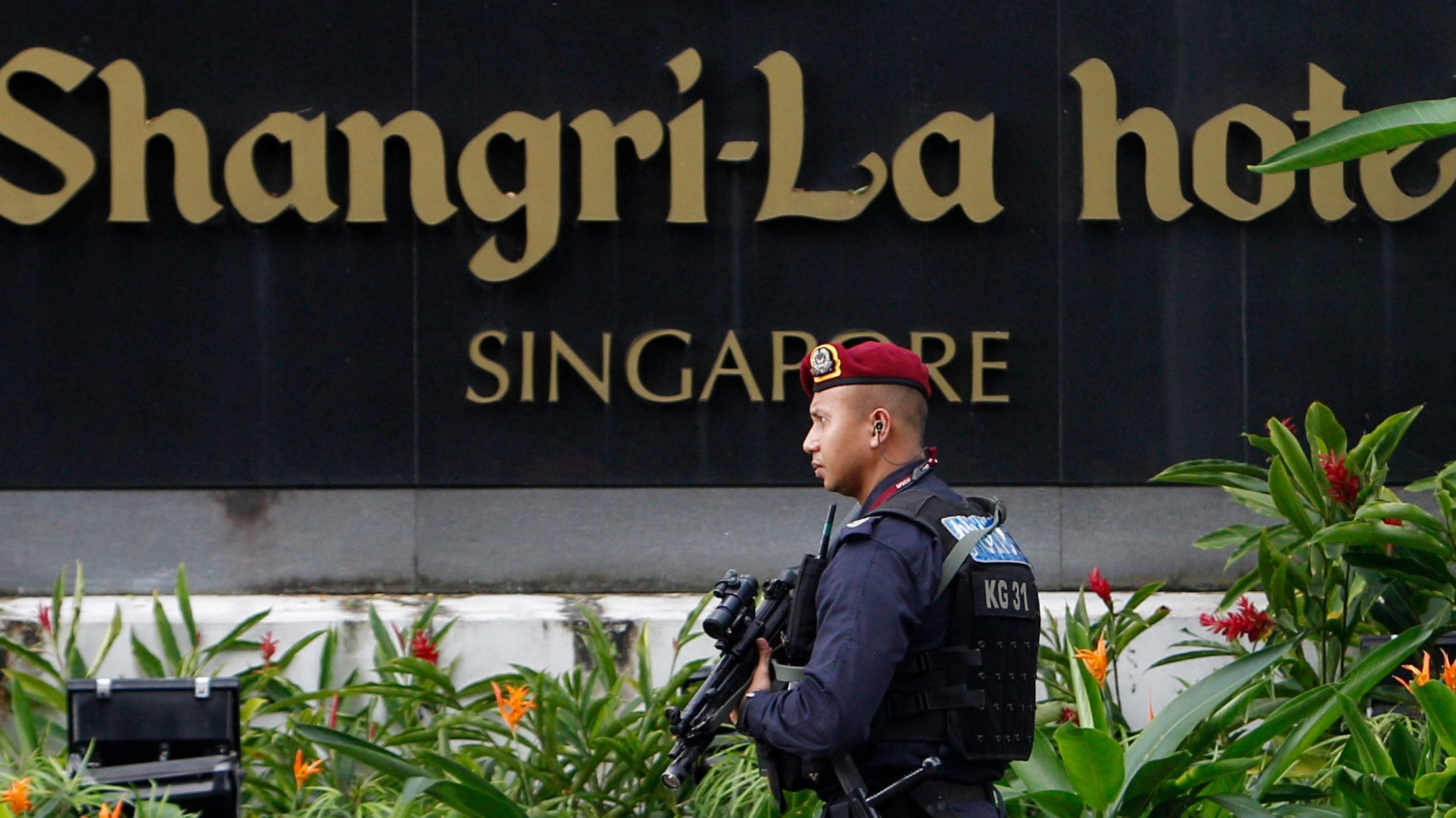 A security personnel patrols outside the hotel where the 12th IISS Asia Security Summit is taking place, in Singapore