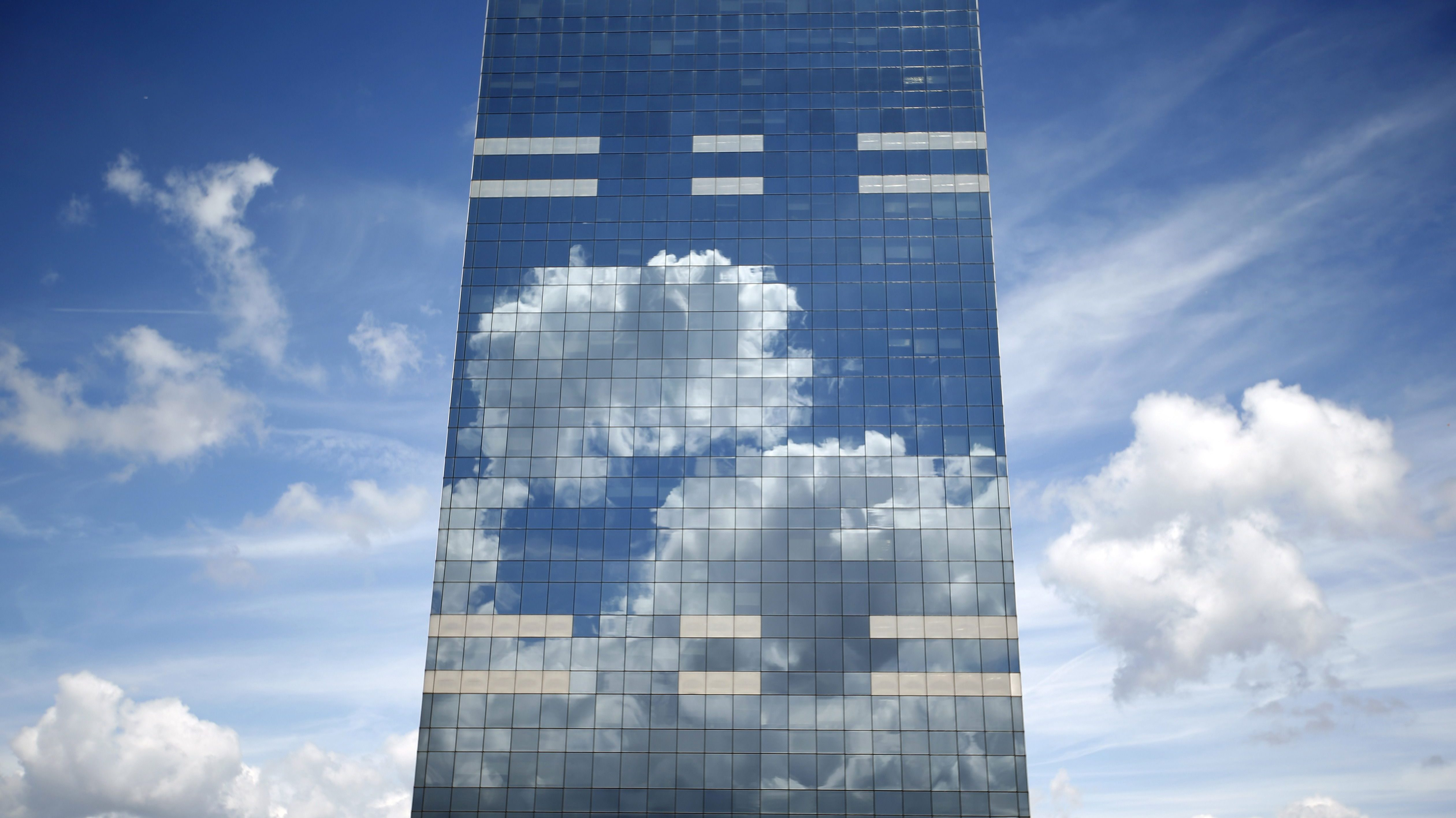 Clouds are reflected in the a tower in downtown Brussels in Belgium June 21, 2015.