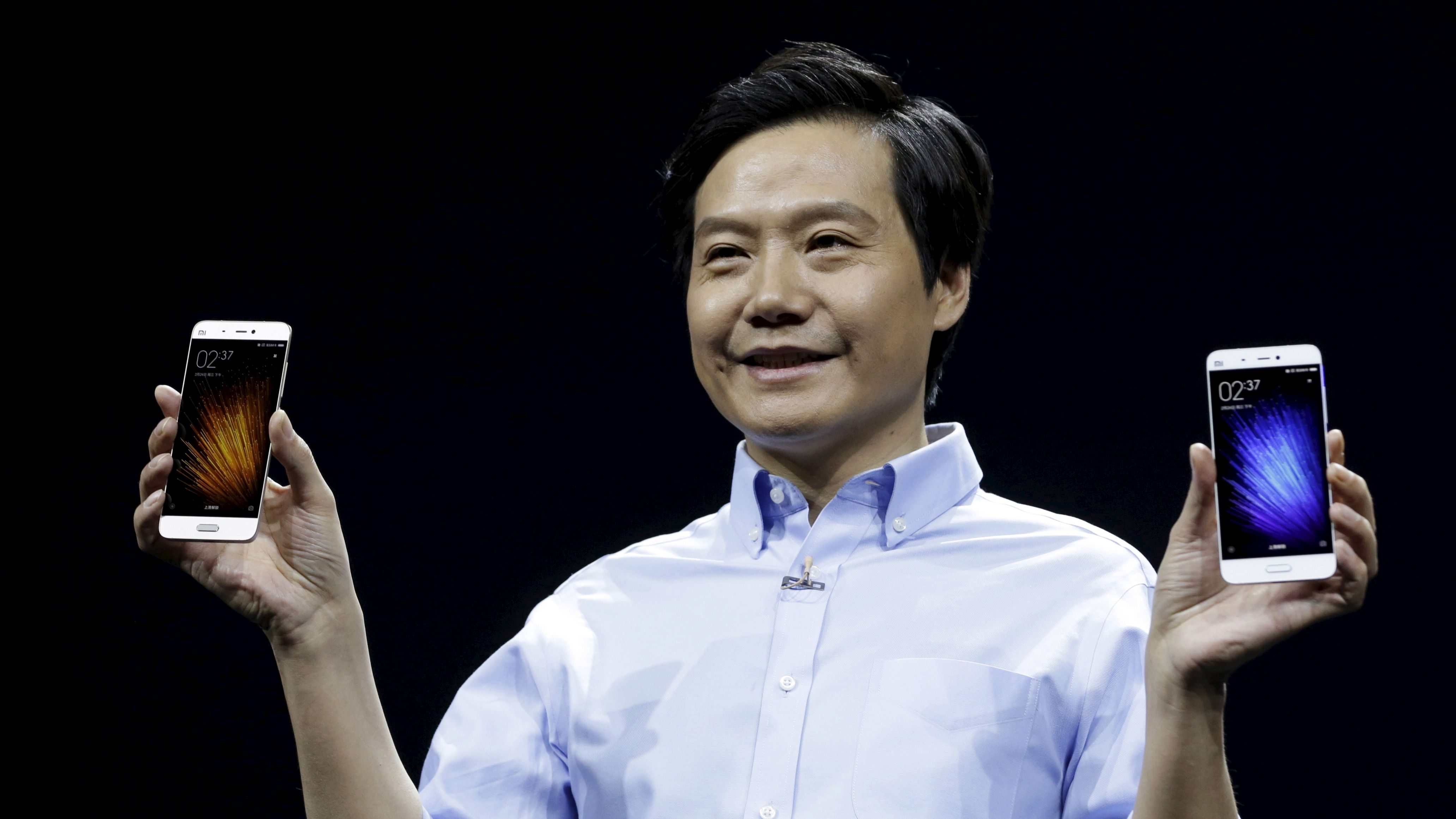 Lei Jun, founder and CEO of China's mobile company Xiaomi, displays Xiaomi Mi 5 at its launch ceremony, in Beijing, China, February 24, 2016.