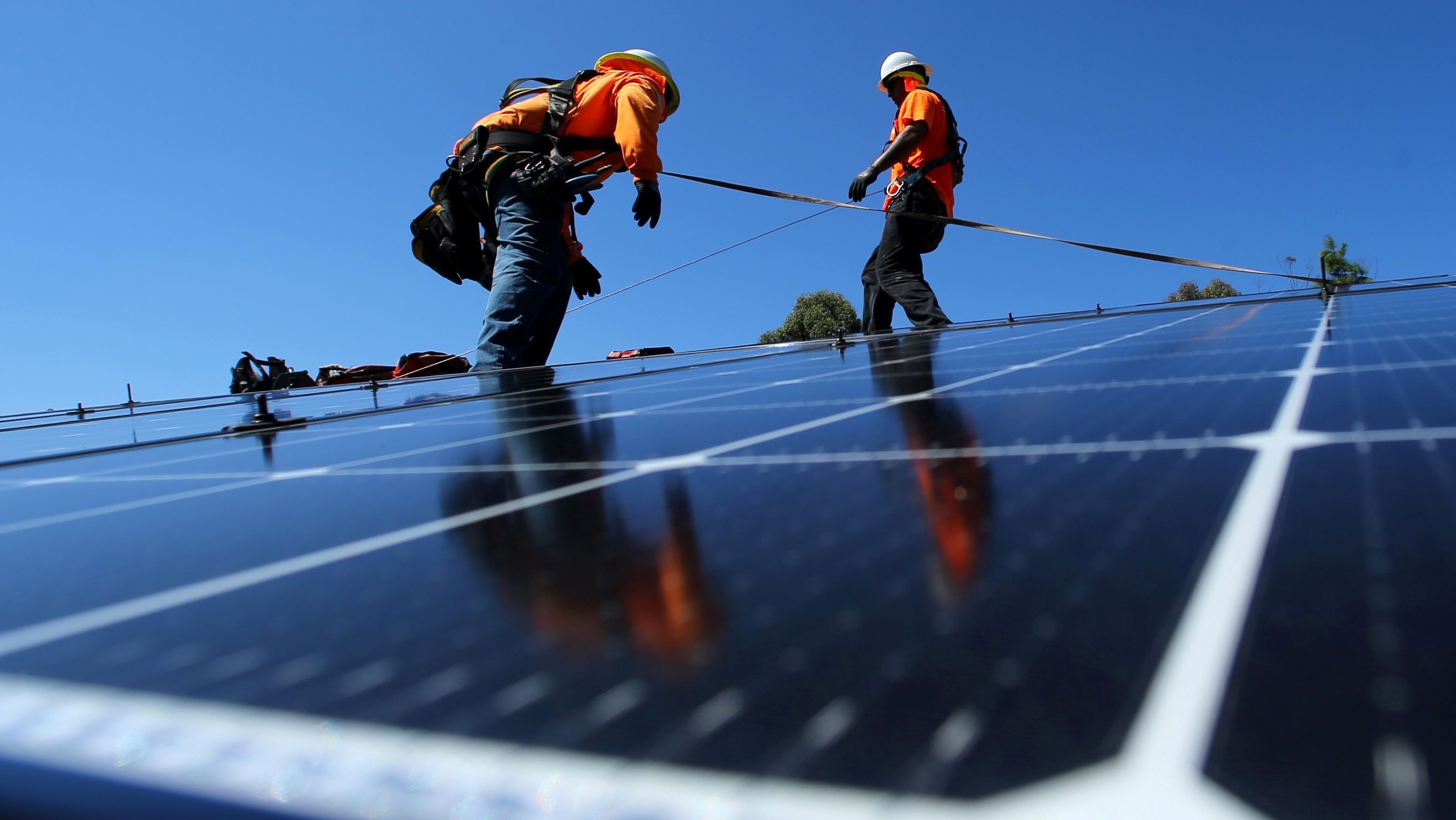 Solar installers from Baker Electric place solar panels on the roof of a residential home in Scripps Ranch, San Diego, California, U.S. October 14, 2016. Picture taken October 14, 2016.