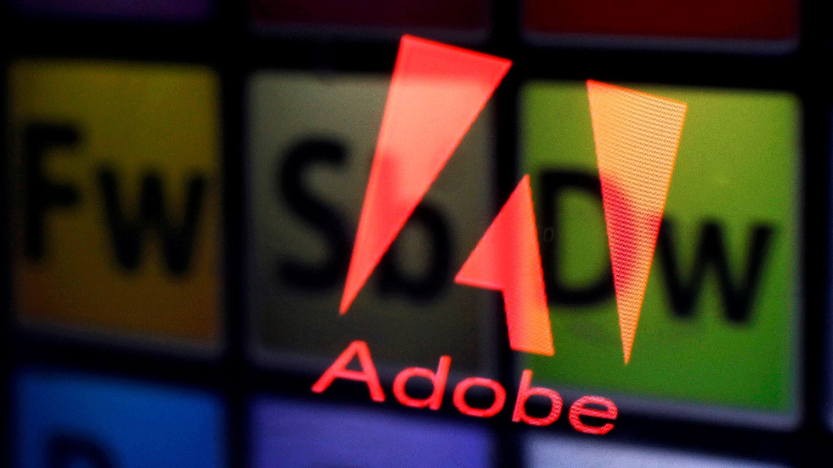 FILE PHOTO: An Adobe logo and Adobe products are seen reflected on a monitor display and an iPad screen, in this picture illustration July 8, 2013.     REUTERS/Dado Ruvic/Illustration/File Photo             GLOBAL BUSINESS WEEK AHEAD PACKAGE Ð SEARCH BUSINESS WEEK AHEAD MARCH 13 FOR ALL IMAGES - RC19C96B58A0