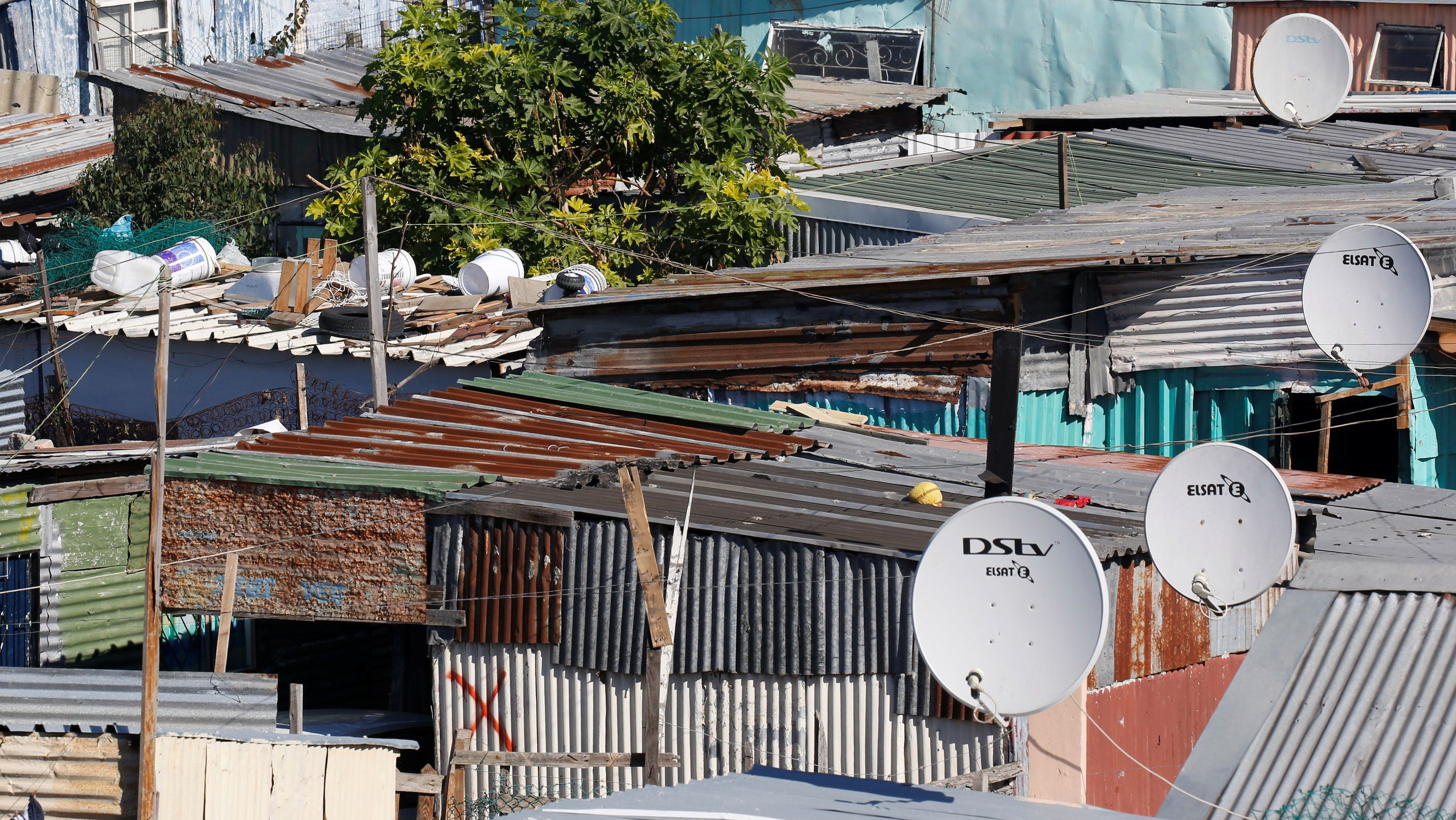 Satellite dishes connect township residents to South Africa's DSTV television network, owned Naspers