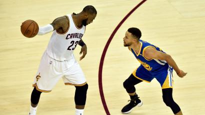 Jun 7, 2017; Cleveland, OH, USA; Cleveland Cavaliers forward LeBron James (23) handles the ball against Golden State Warriors guard Stephen Curry (30) during the fourth quarter in game three of the 2017 NBA Finals at Quicken Loans Arena.