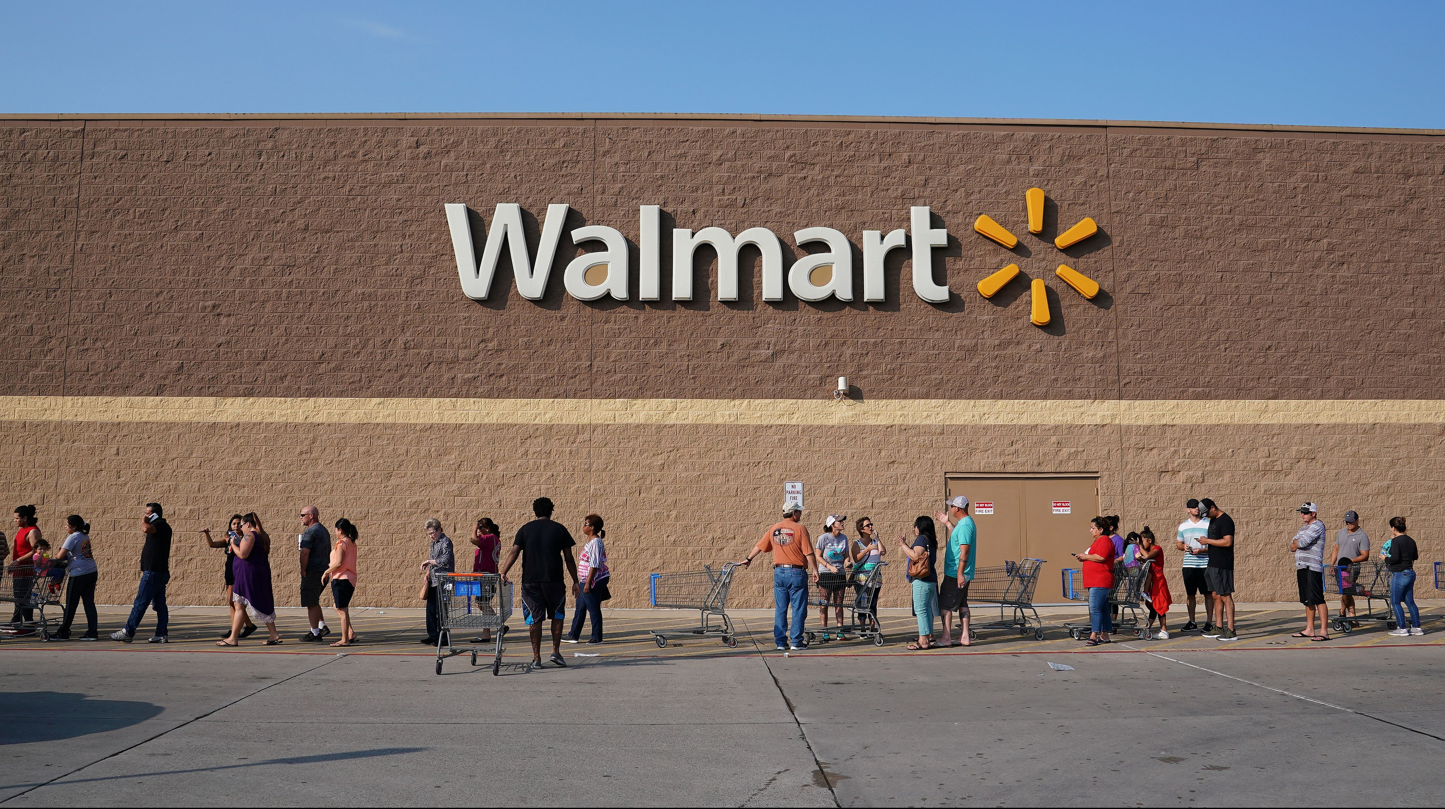 People line up at a Walmart store that reopened Friday after Tropical Storm Harvey in Port Arthur, Texas, U.S., September 1, 2017.