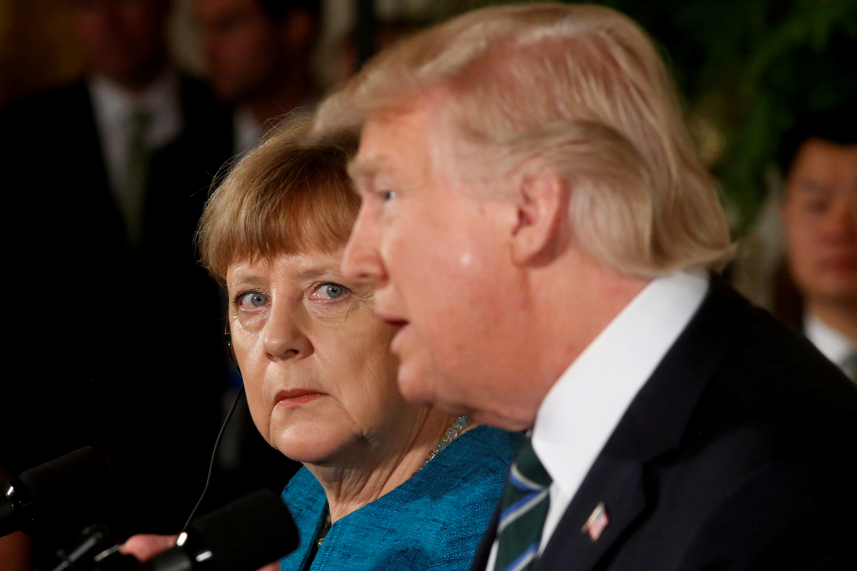 """Germany's Chancellor Angela Merkel and U.S. President Donald Trump hold a joint news conference in the East Room of the White House in Washington, U.S., March 17, 2017. Jonathan Ernst: """"Chancellor Merkel made one of the earliest important visits of any U.S. allies to meet Trump in his first months in office. When world leaders give joint news conferences they don't always tend to give each other their full attention - but Merkel watched Trump intently at several key moments, and here seemed particularly rapt."""" REUTERS/Jonathan Ernst/File Photo  SEARCH """"POY TRUMP"""" FOR THIS STORY. SEARCH """"REUTERS POY"""" FOR ALL BEST OF 2017 PACKAGES.    TPX IMAGES OF THE DAY - RC19ADFDA180"""