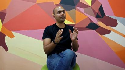 Manu Kumar Jain, Managing Director of Xiaomi India, gestures as he speaks during an interview with Reuters inside his office in Bengaluru