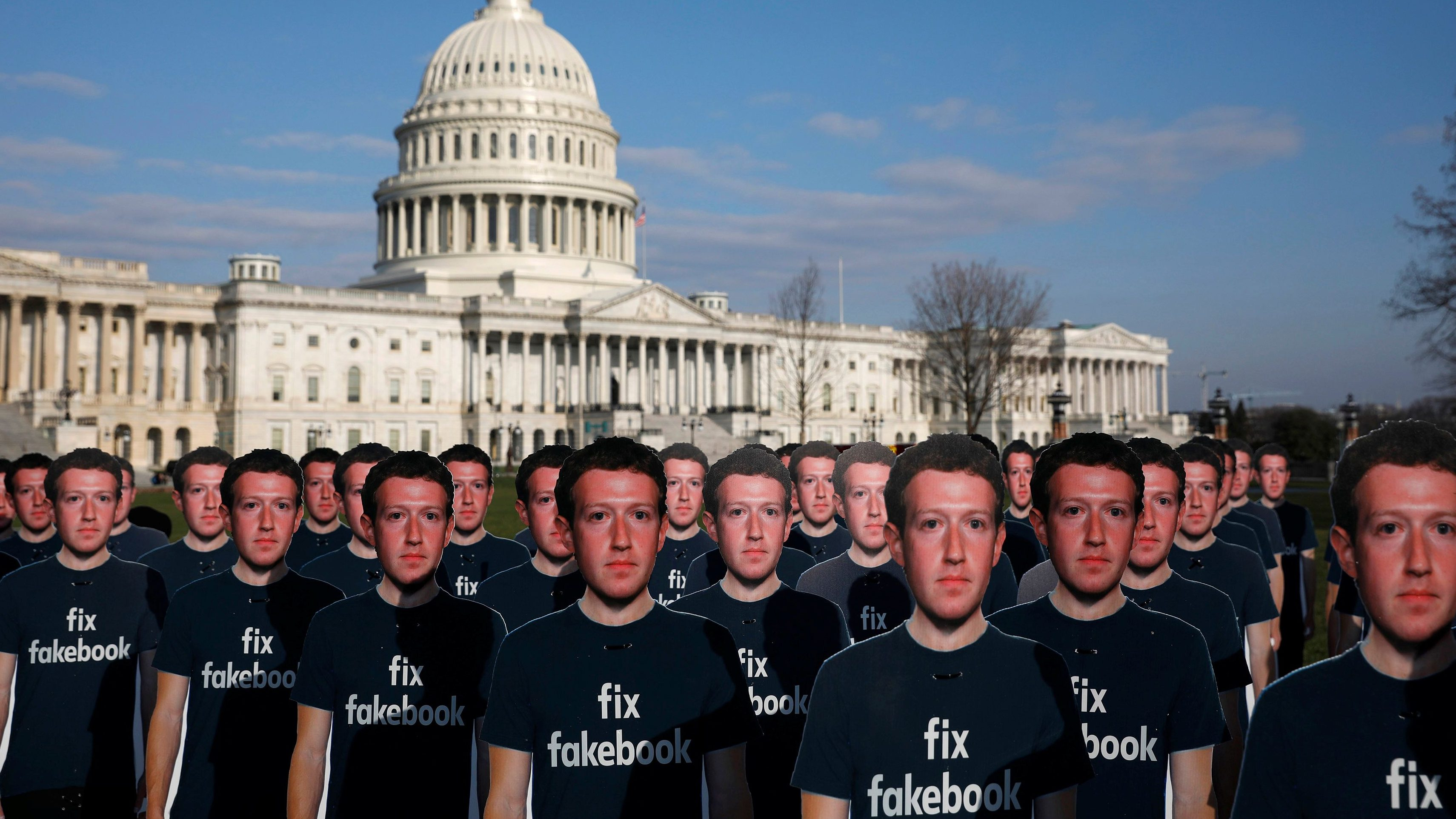Dozens of cardboard cutouts of Facebook CEO Mark Zuckerberg are seen during an Avaaz.org protest outside the U.S. Capitol in Washington, U.S., April 10, 2018. REUTERS/Aaron P. Bernstein - RC140BEB31A0
