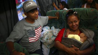 Central American migrants, moving in a caravan through Mexico