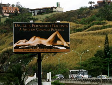 "A billboard proclaiming ""the art of plastic surgery"""