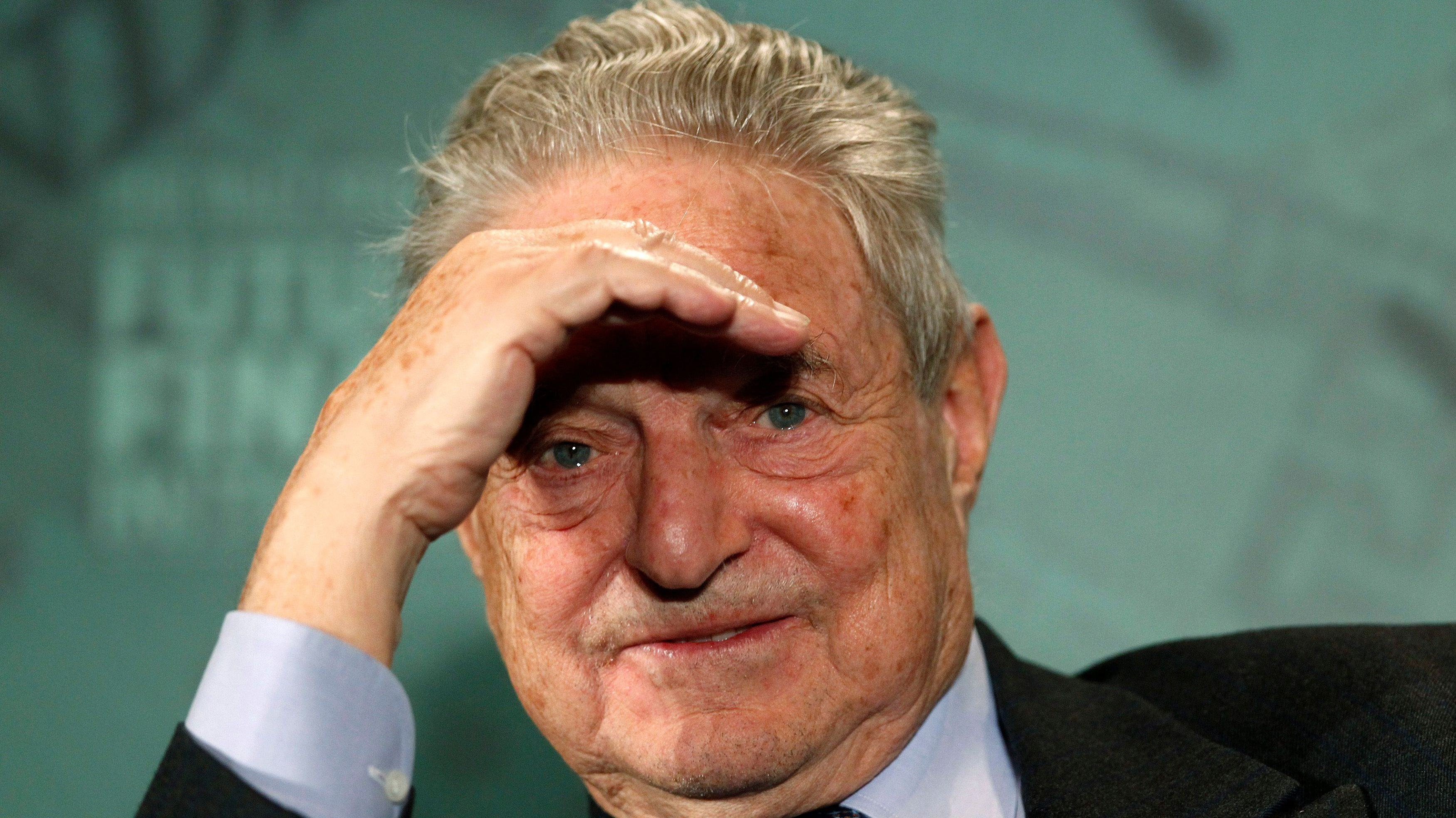 George  Soros, Chairman of Soros Fund Management, listens during a Future of Finance Initiative conference in Horsham, southern England