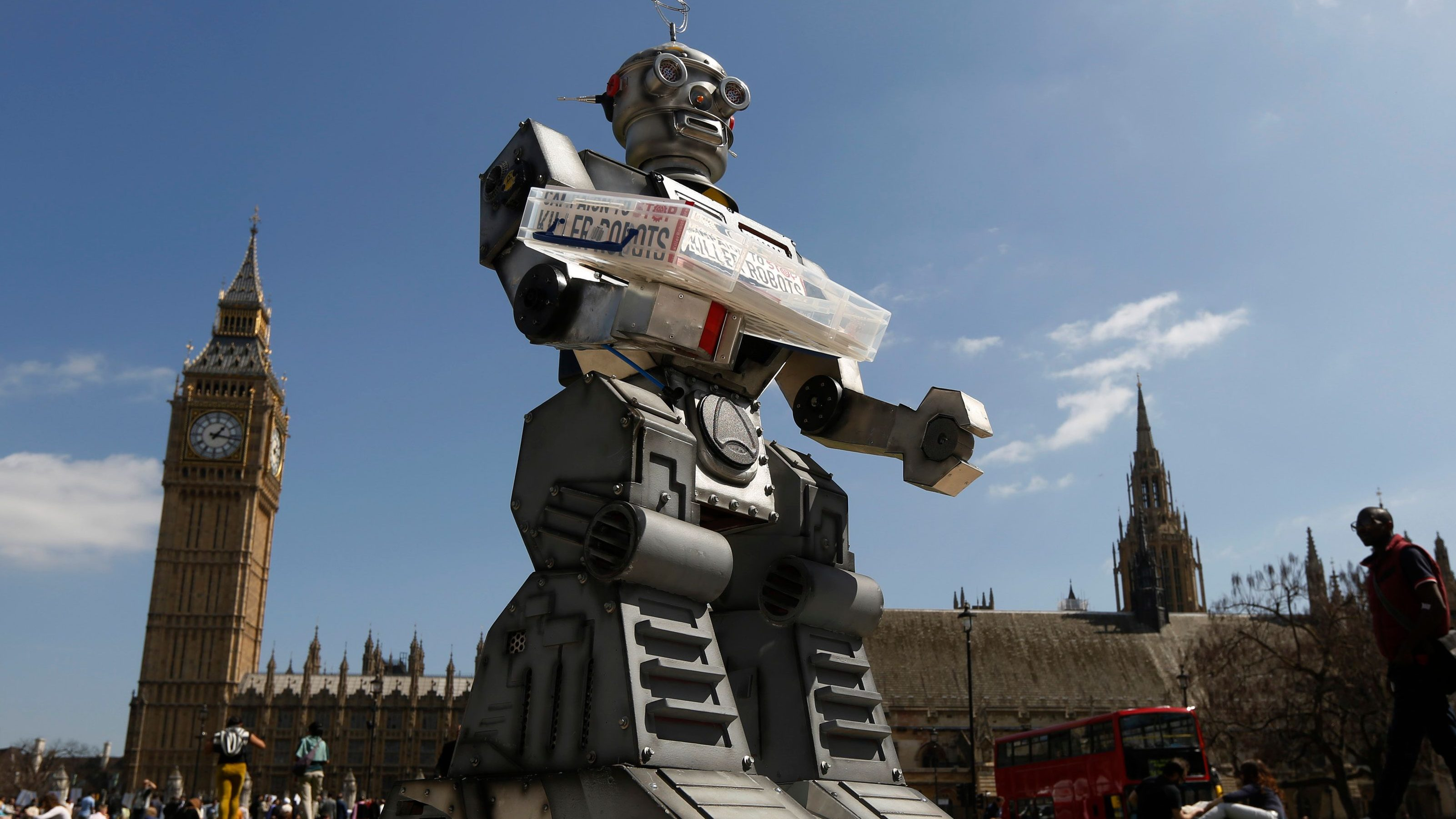 A robot is pictured in front of the Houses of Parliament and Westminster Abbey as part of the Campaign to Stop Killer Robots in London.