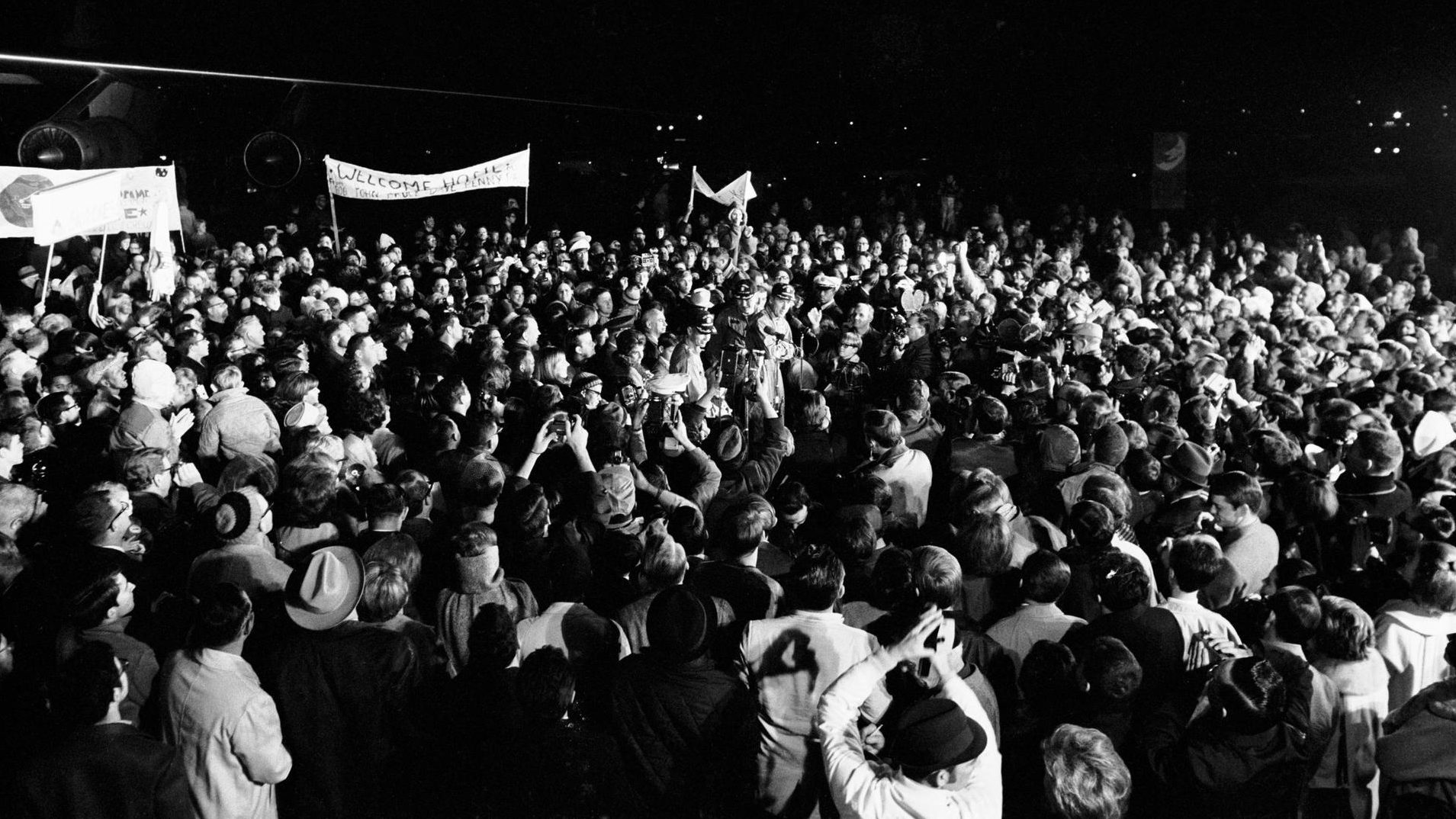 (29 Dec. 1968) --- Although it was past 2 a.m., a crew of more than 2,000 people were on hand at Ellington Air Force Base to welcome the members of the Apollo 8 crew back home. Astronauts Frank Borman, James A. Lovell Jr., and William A. Anders had just flown to Houston from the pacific recovery area by way of Hawaii. The three crewmen of the historic Apollo 8 lunar orbit mission are standing at the microphones in center of picture.
