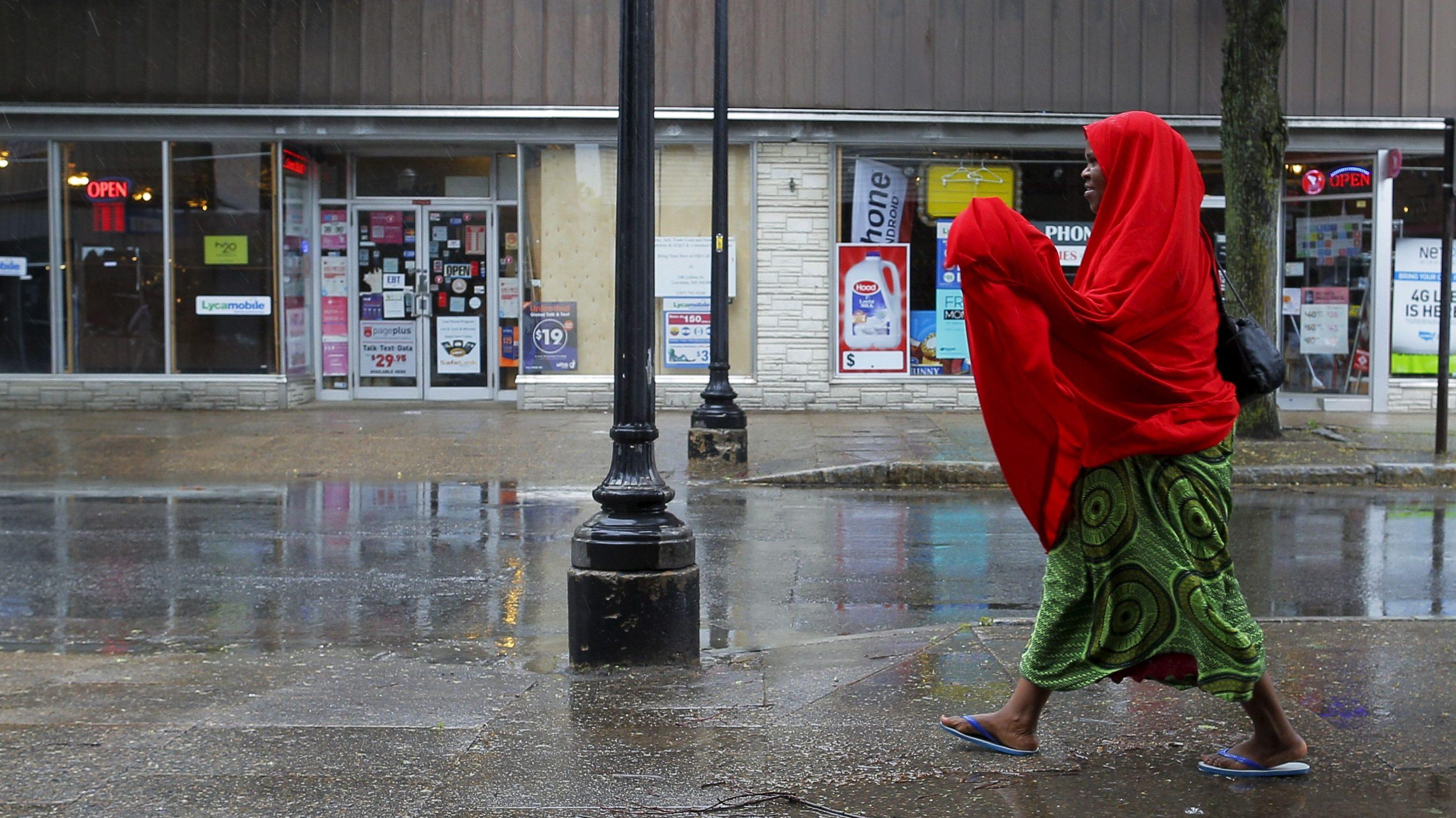 A Somali woman walks along a street in downtown Lewiston, Maine.