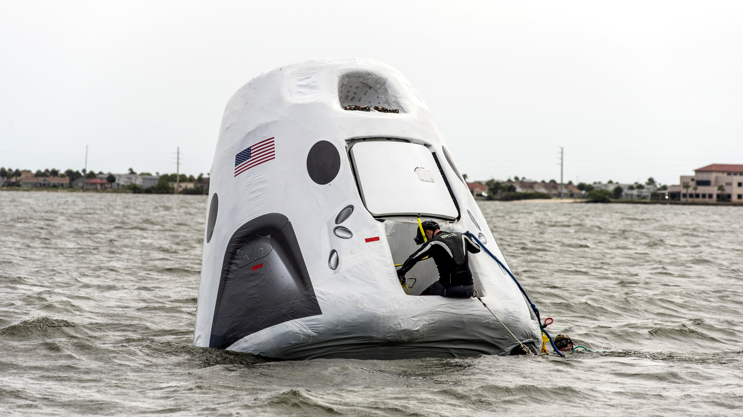 Personnel from NASA, SpaceX and the U.S. Air Force have begun practicing recovery operations for the SpaceX Crew Dragon. Using a full-size model of the spacecraft that will take astronauts to the International Space Station, Air Force parajumpers practice helping astronauts out of the SpaceX Crew Dragon following a mission.