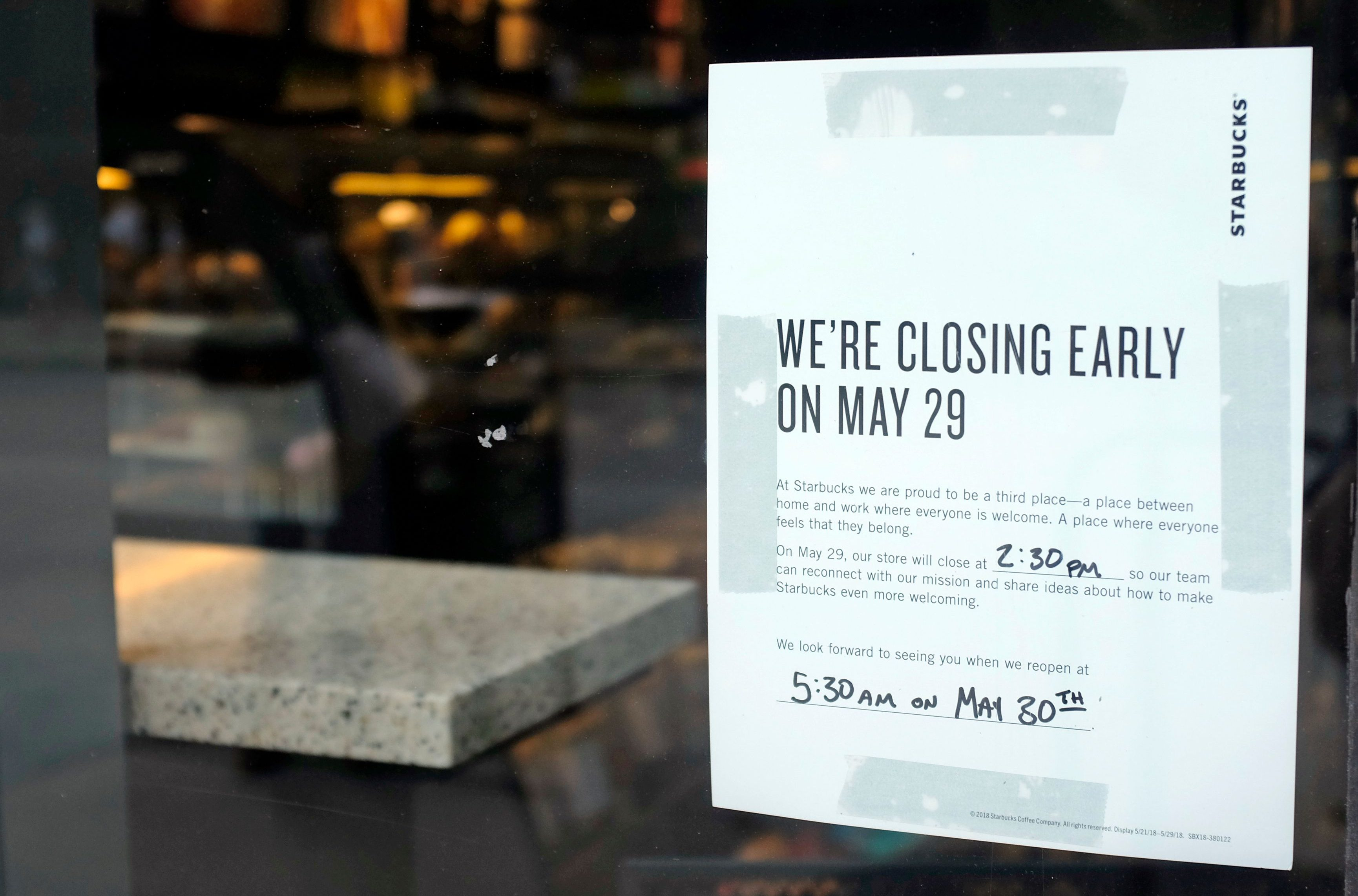 A store closing sign for May 25 is posted outside of a Starbucks store, Friday, May 25, 2018, in Chicago.