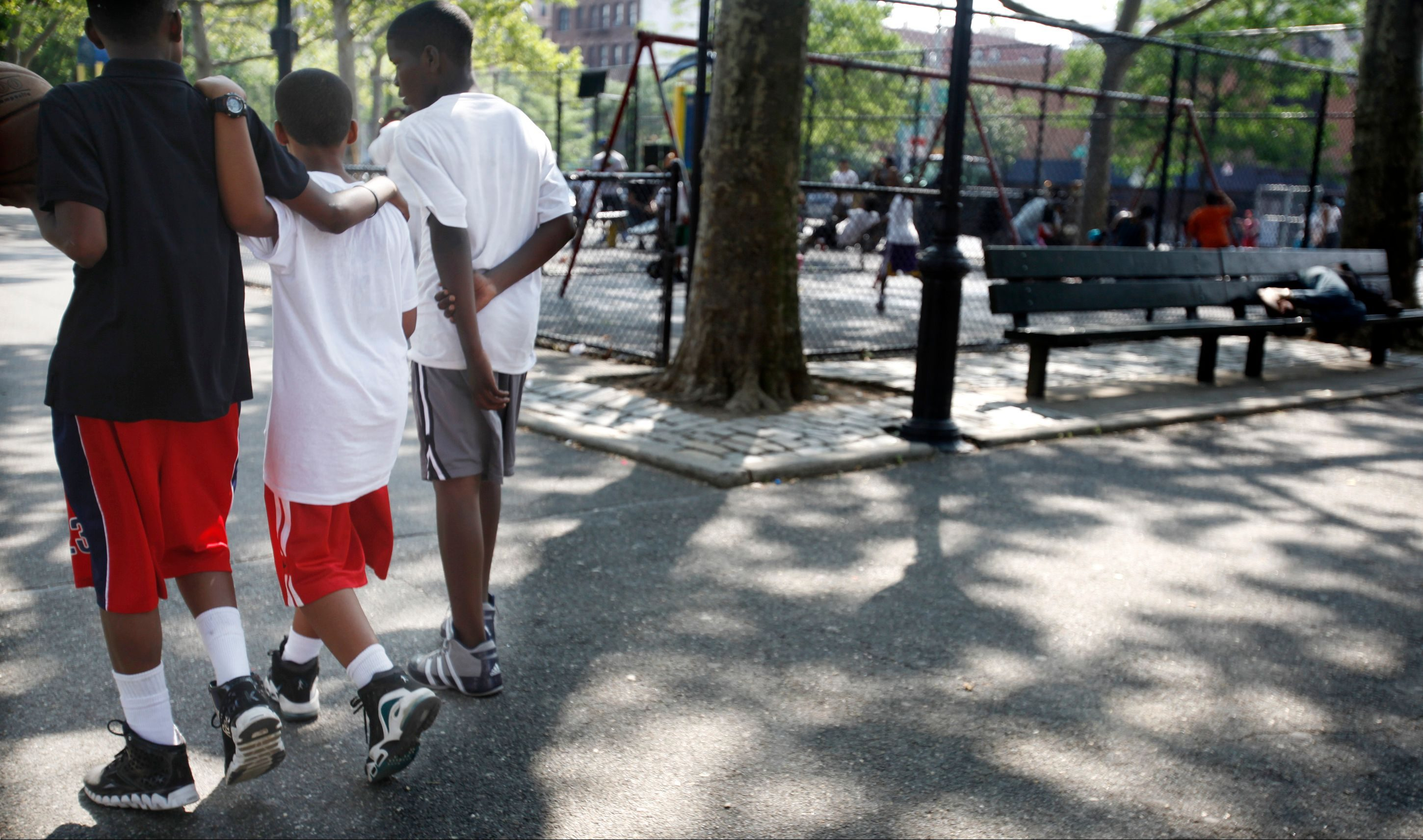 Youngsters leave a basketball court at the Colonel Charles Young playground in Harlem, N.Y., on Tuesday, June 28, 2011
