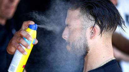 Chicago White Sox second baseman Carlos Sanchez sprays on sunscreen in the dugout prior to the team's spring training baseball game against the Los Angeles Dodgers in 2017.